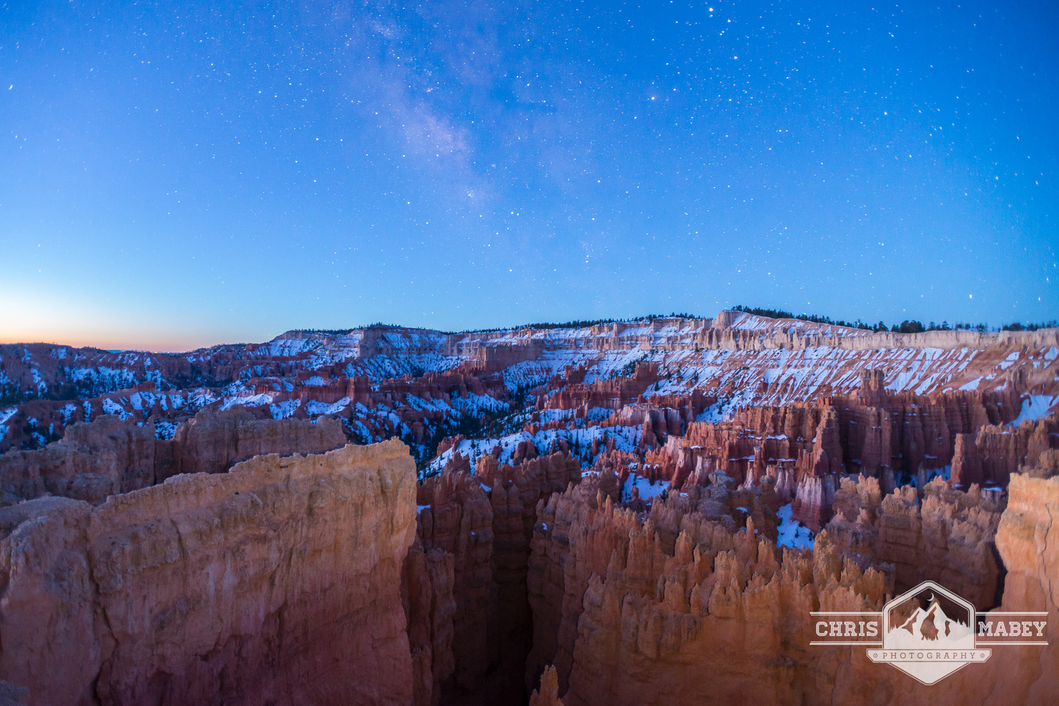 The Milky Way hangs in the air over Bryce Canyon as the sun approaches