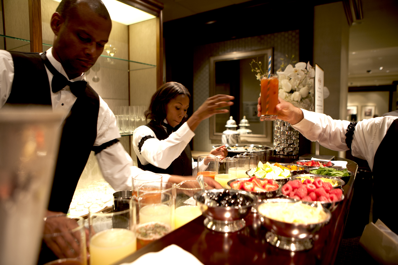 Bartenders create cocktails
