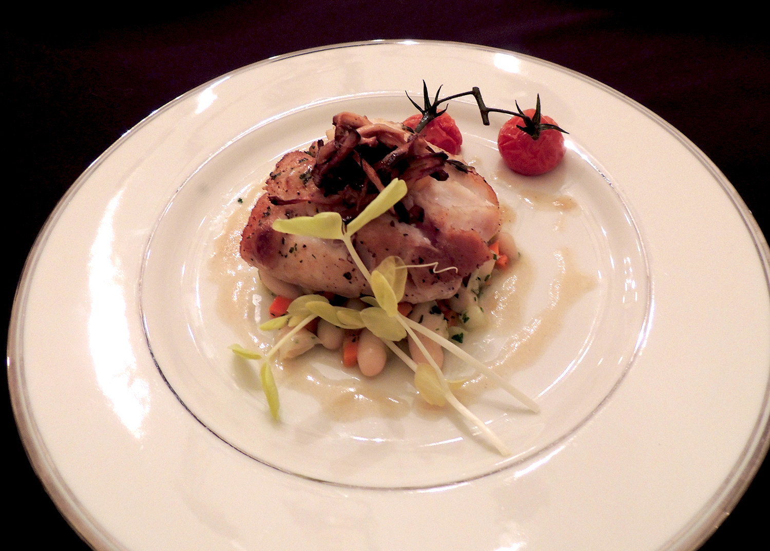 Seared blue nose sea bass, cannelini bean-cherry tomato ragout, chanterelle mushrooms