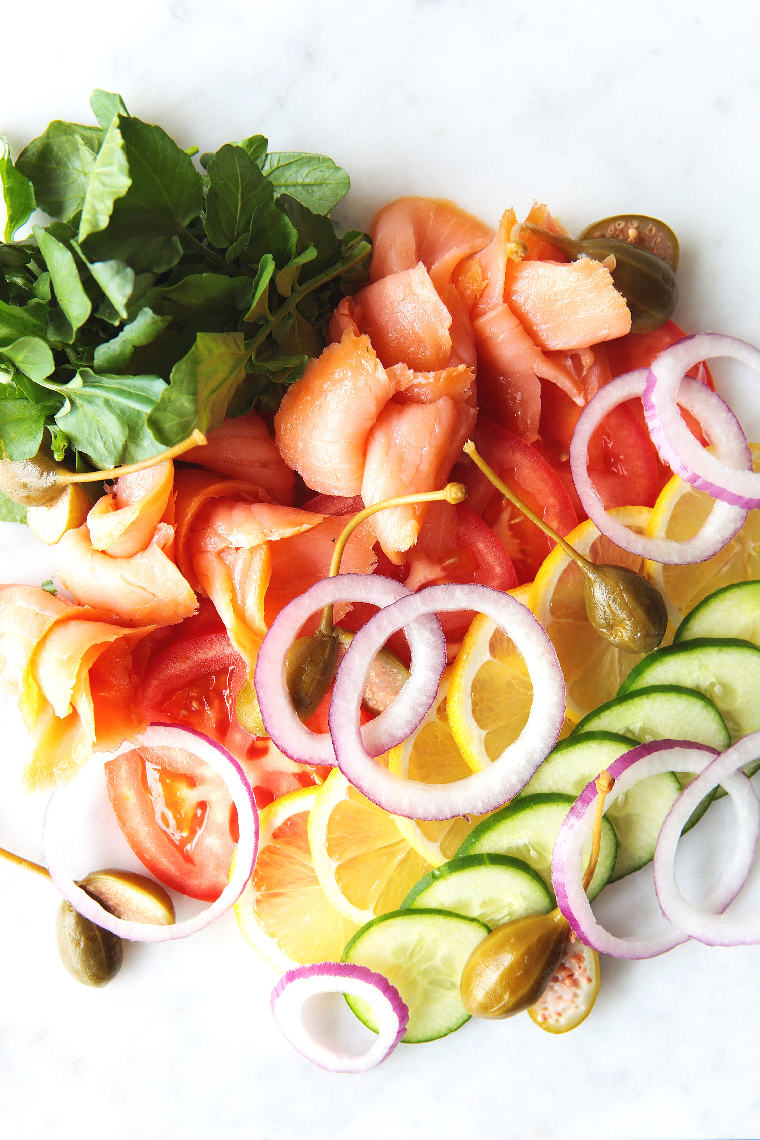 Smoked and cured lox with sliced tomato, cucumber, red onions and capers