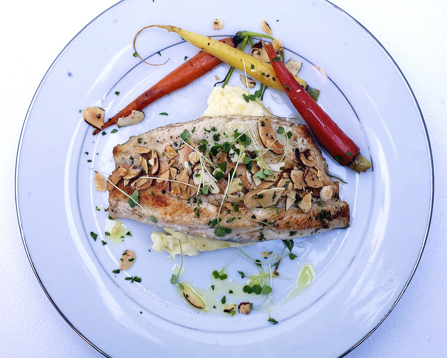 Almond crusted sea bass with roasted heirloom carrots