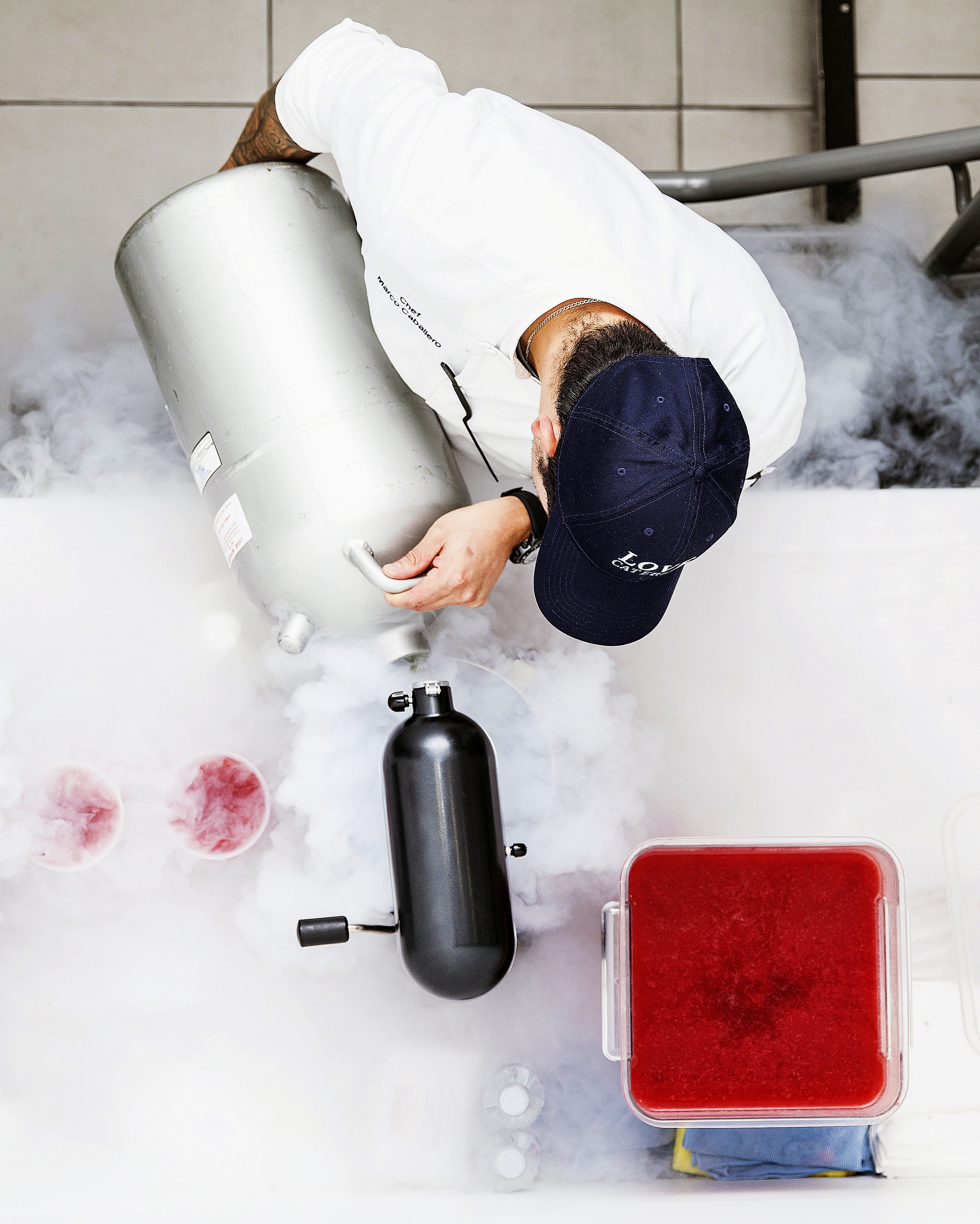 Preparing liquid nitrogen infused sex on the beach cocktails