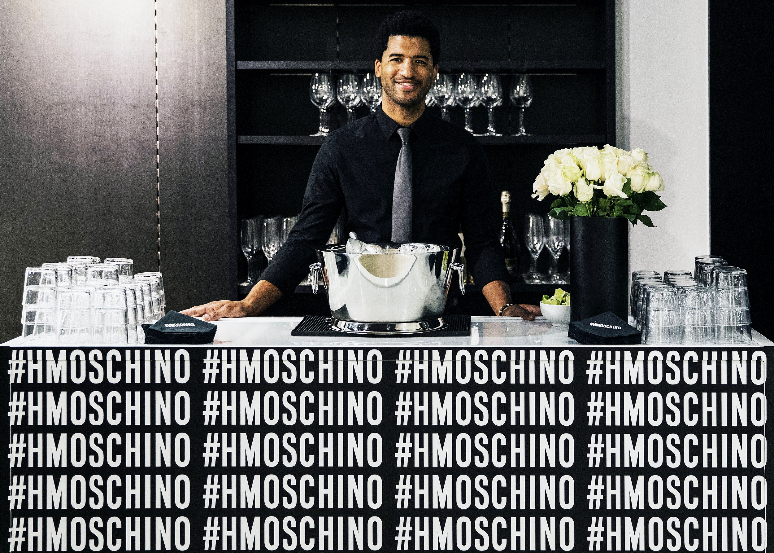 Bartender at custom Moschino x H&M bar