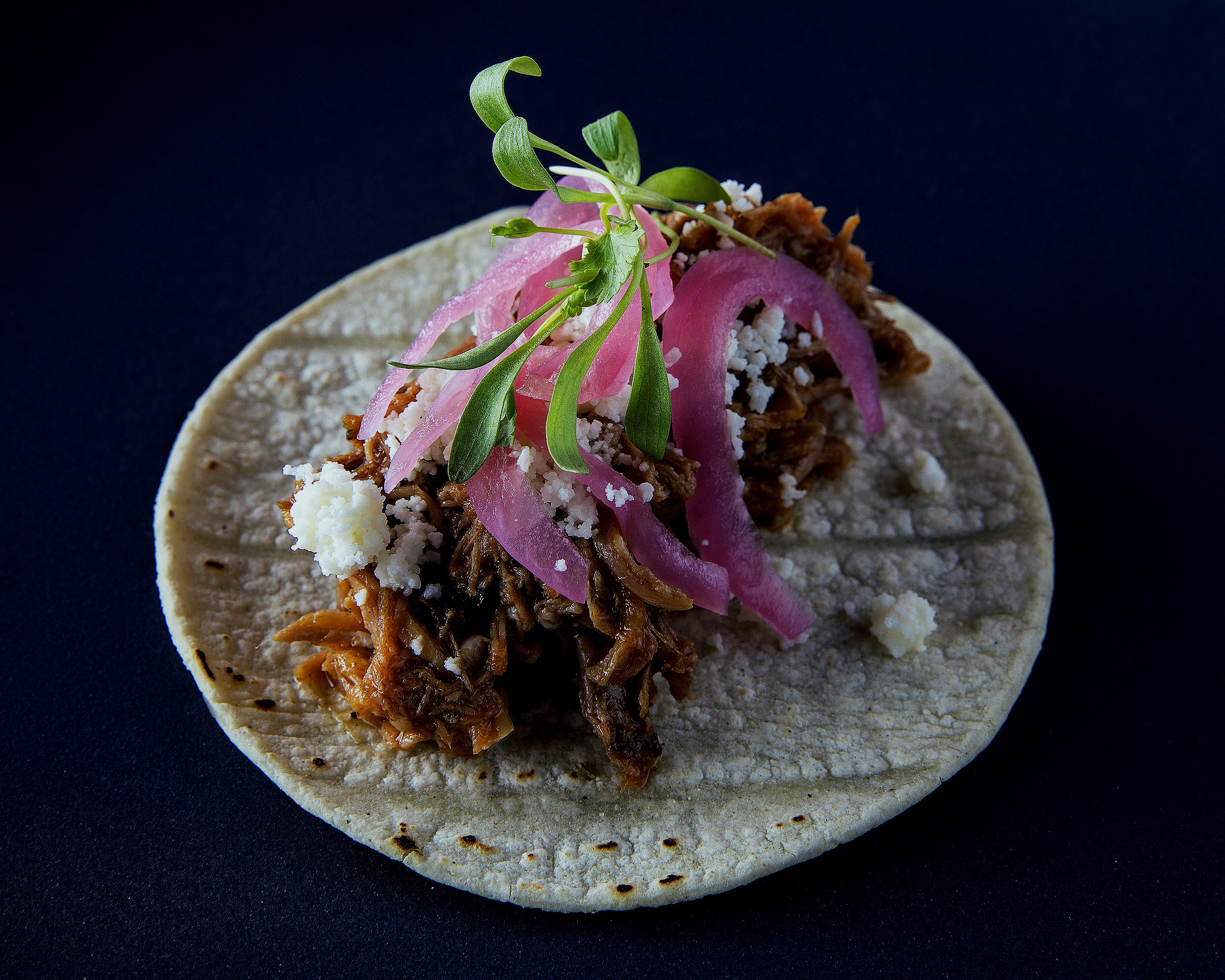 Pulled pork tacos with Cojita and pickled red onions