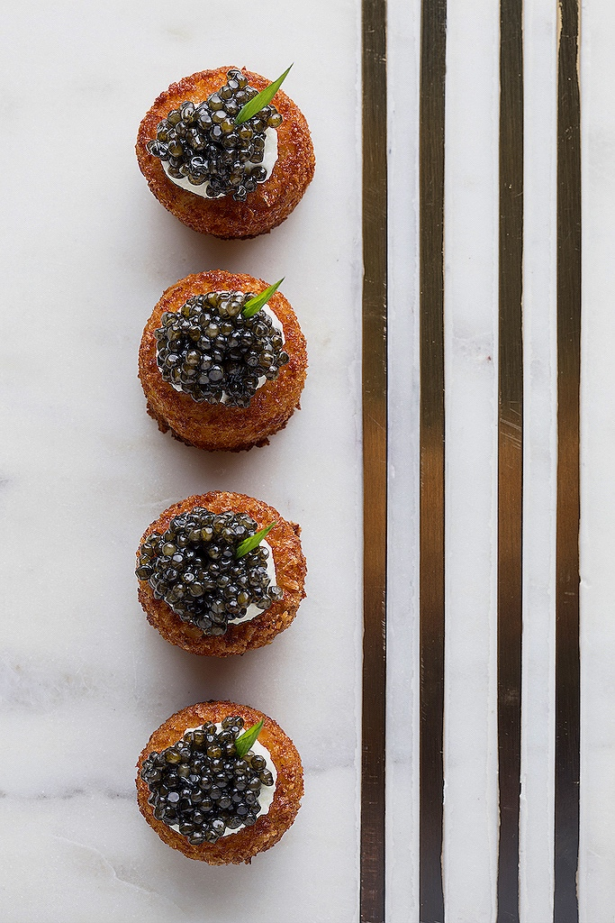 Crab cakes with lemon cream, caviar, and chive