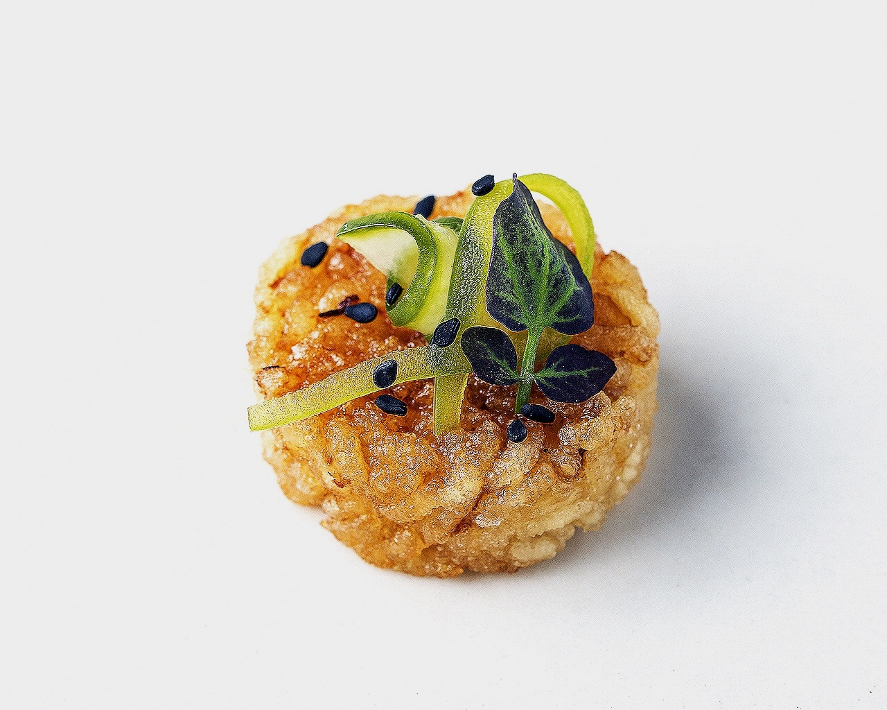 Fried rice bite with pickled cucumber, peppers and sweet soy ginger sauce