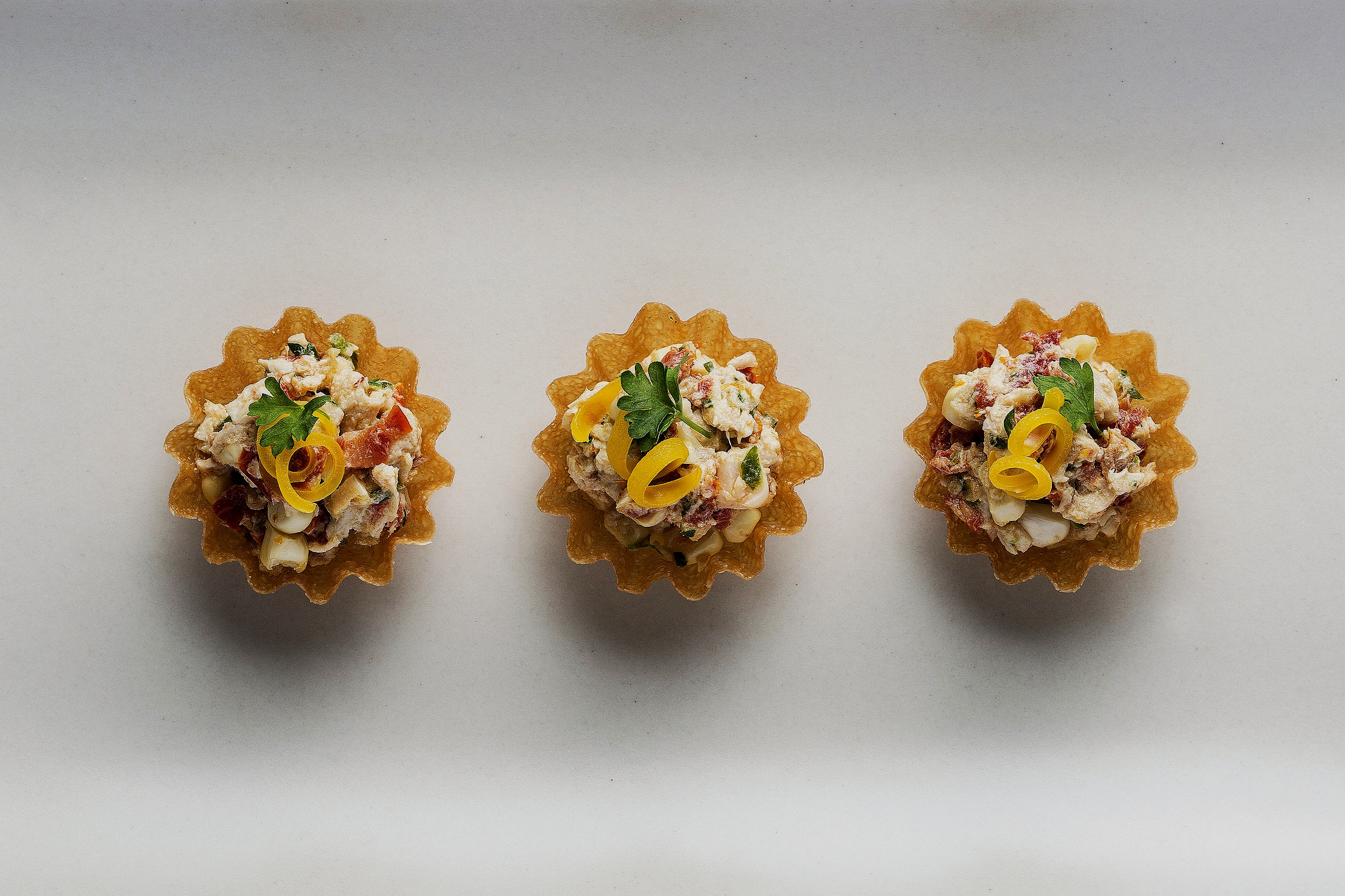 Tart with chicken, sun-dried tomato, lemon, creme fraiche, corn, and yellow pepper