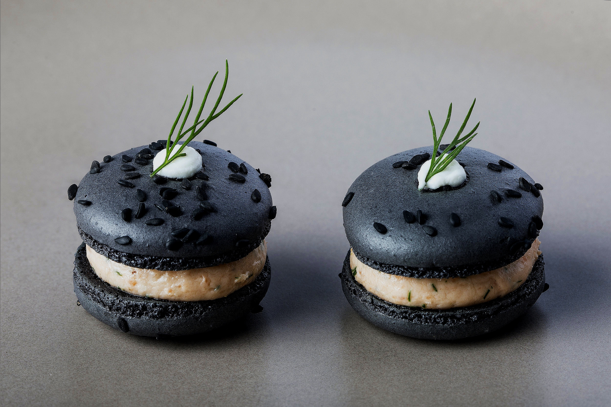 Savory macaron with smoked salmon, cream cheese, dill, and black sesame