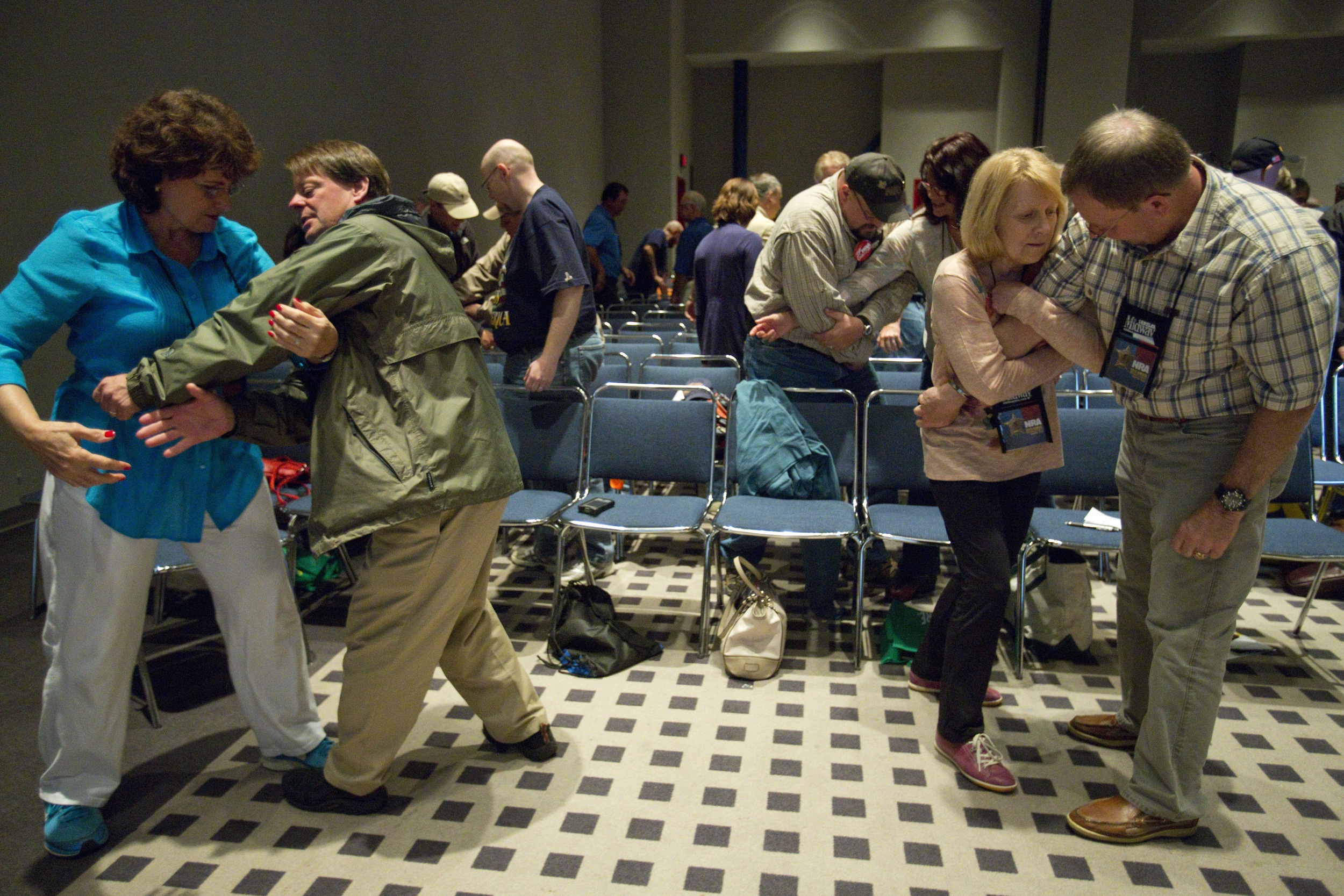 Philip and Kitty Cox, of Memphis , TN, left, and John and Linda Kimble, of Denver, CO, practice handgun retention techniques during a workshop at the 2013 National Rifle Association Meeting and Exhibits May 4, 2013 in Houston.