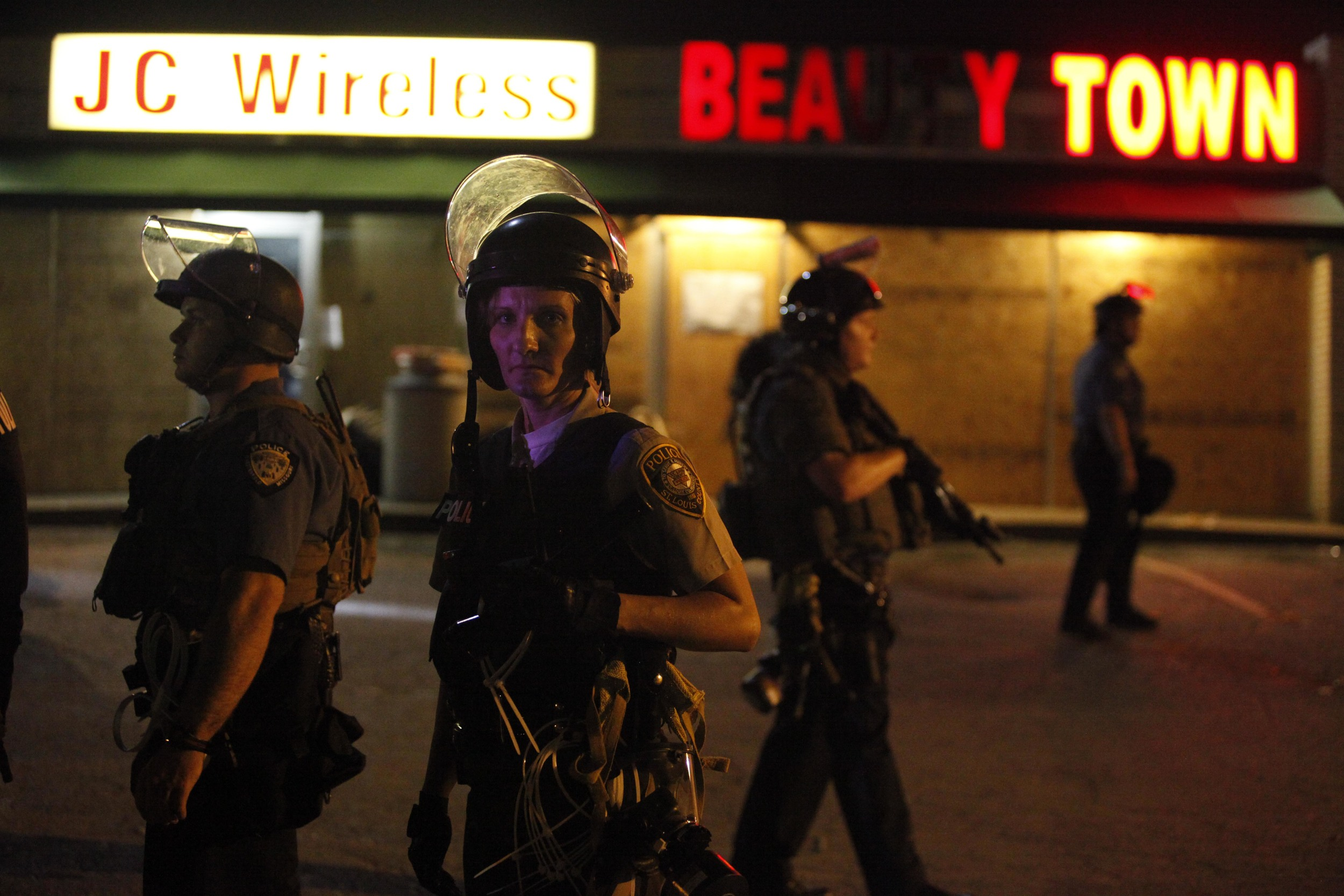 A police officer glares at a photographer August 19, 2014 in Ferguson, MO.