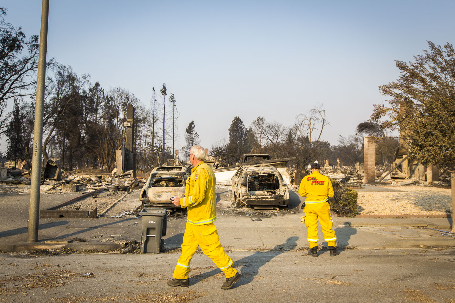 Cal Fire officials survey the damage of a devastating fire in the Coffey Park neighborhood Oct. 13, 2017 in Santa Rosa, CA.