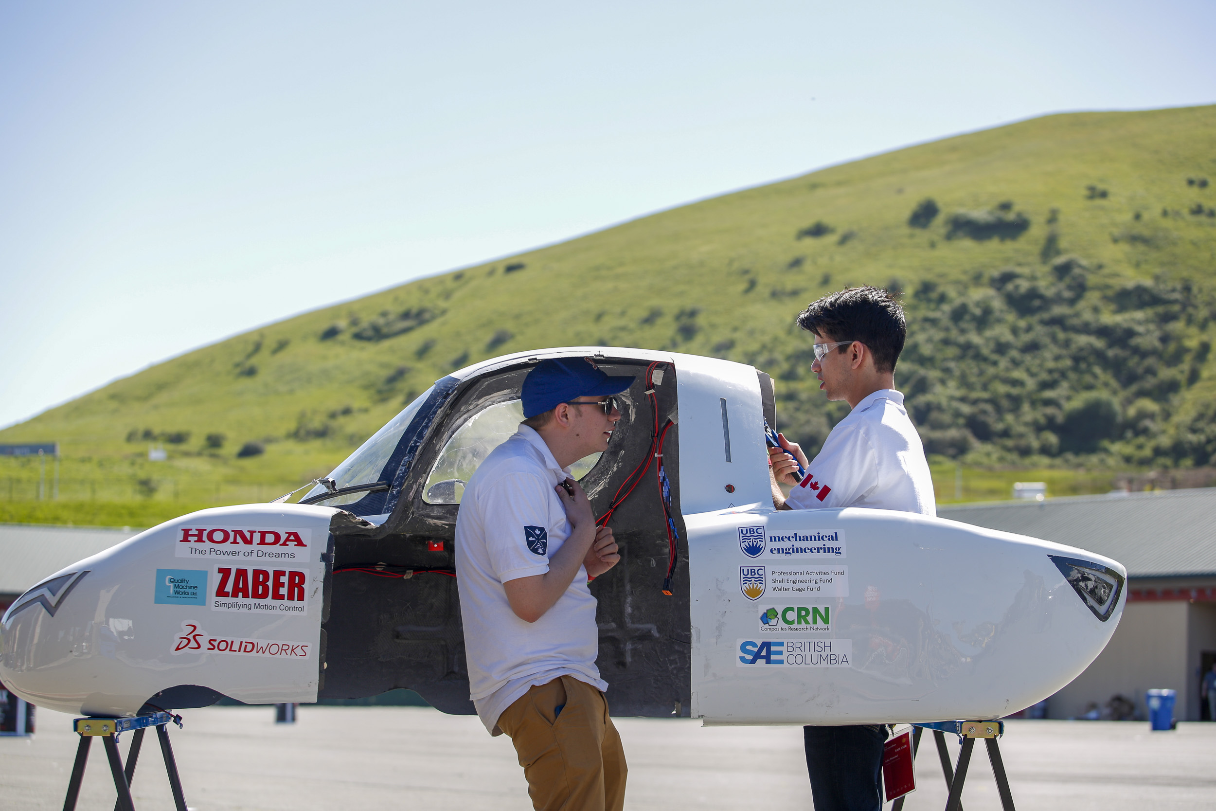 UBC Supermileage Team with their vehicle the Zephyr,  #520,  from University of British Columbia , Vancouver, BC, Canada, competing under the UrbanConcept - Gasoline category work on their car near the paddock during day two of Shell Make the Future at Sonoma Raceway, Friday, April 20, 2018 in Sonoma, Calif.