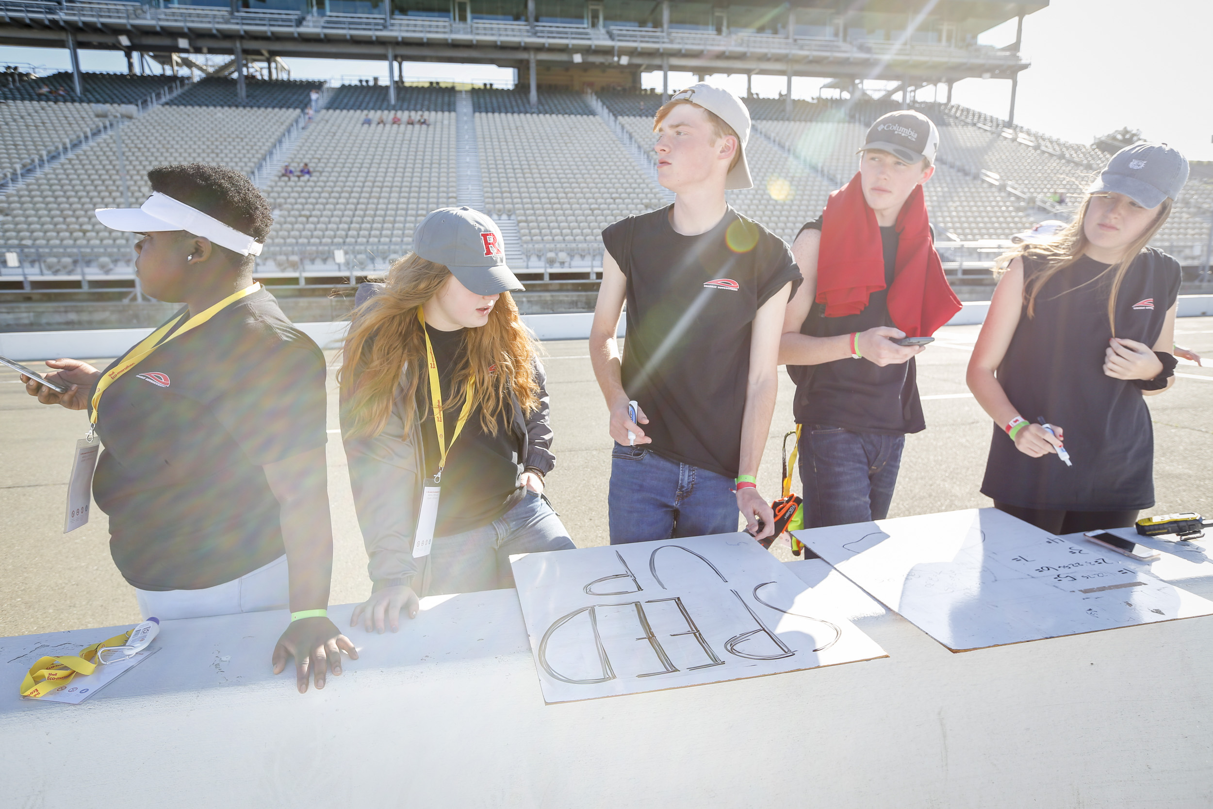Team members prepare signage to signal their driver during day three of Shell Make the Future at Sonoma Raceway, Saturday, April 21, 2018 in Sonoma, Calif.