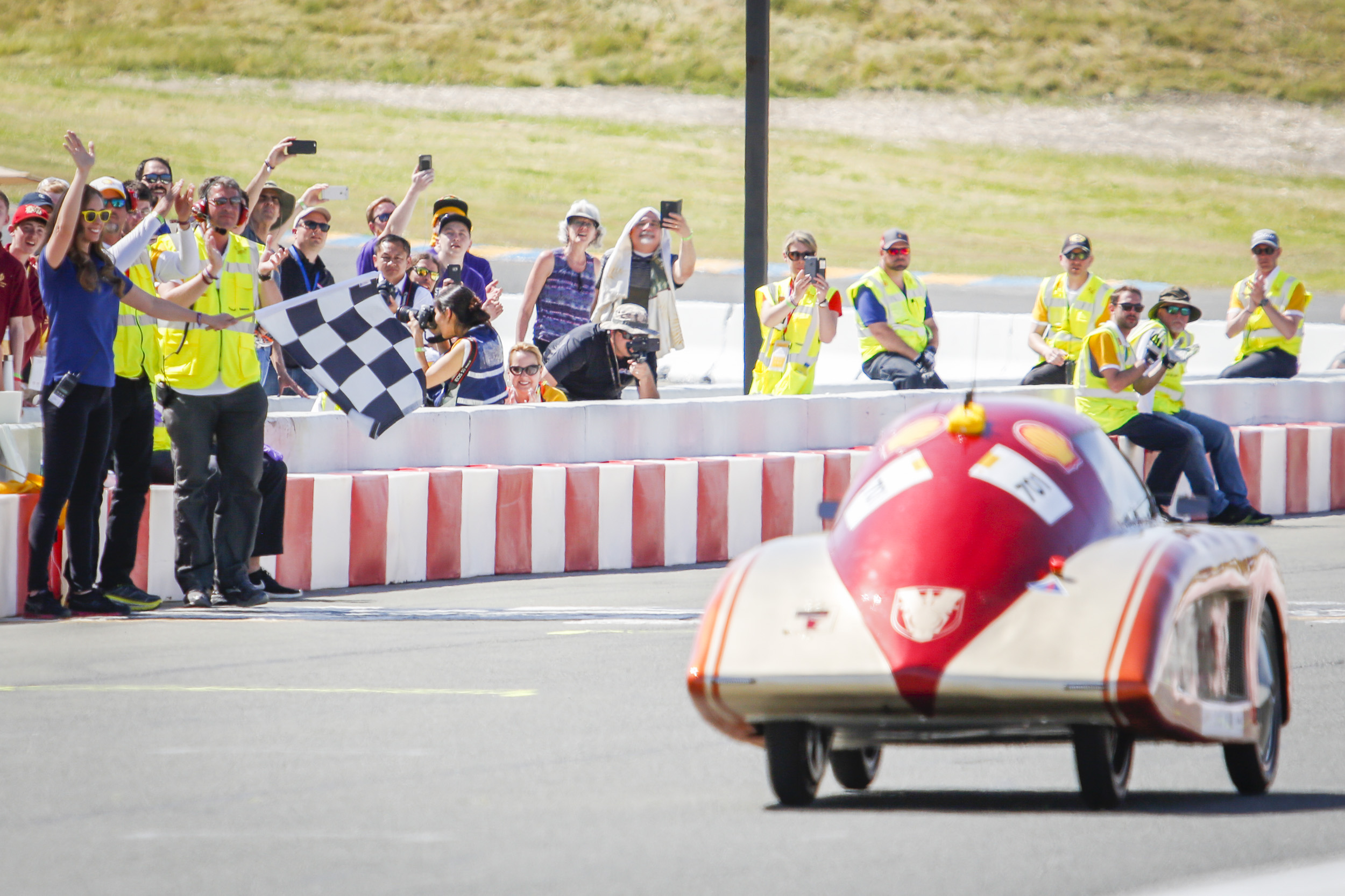 Saint Thomas Academy Experimental Vehicle Team Alpha with their vehicle the The Doppler Effect,  #701,  from Saint Thomas Academy, Mendota Heights, MN, United States, competing under the UrbanConcept - Battery Electric category gets the checkered flag during the Drivers World Championship on the final day of Shell Make the Future at Sonoma Raceway, Sunday, April 22, 2018 in Sonoma, Calif.