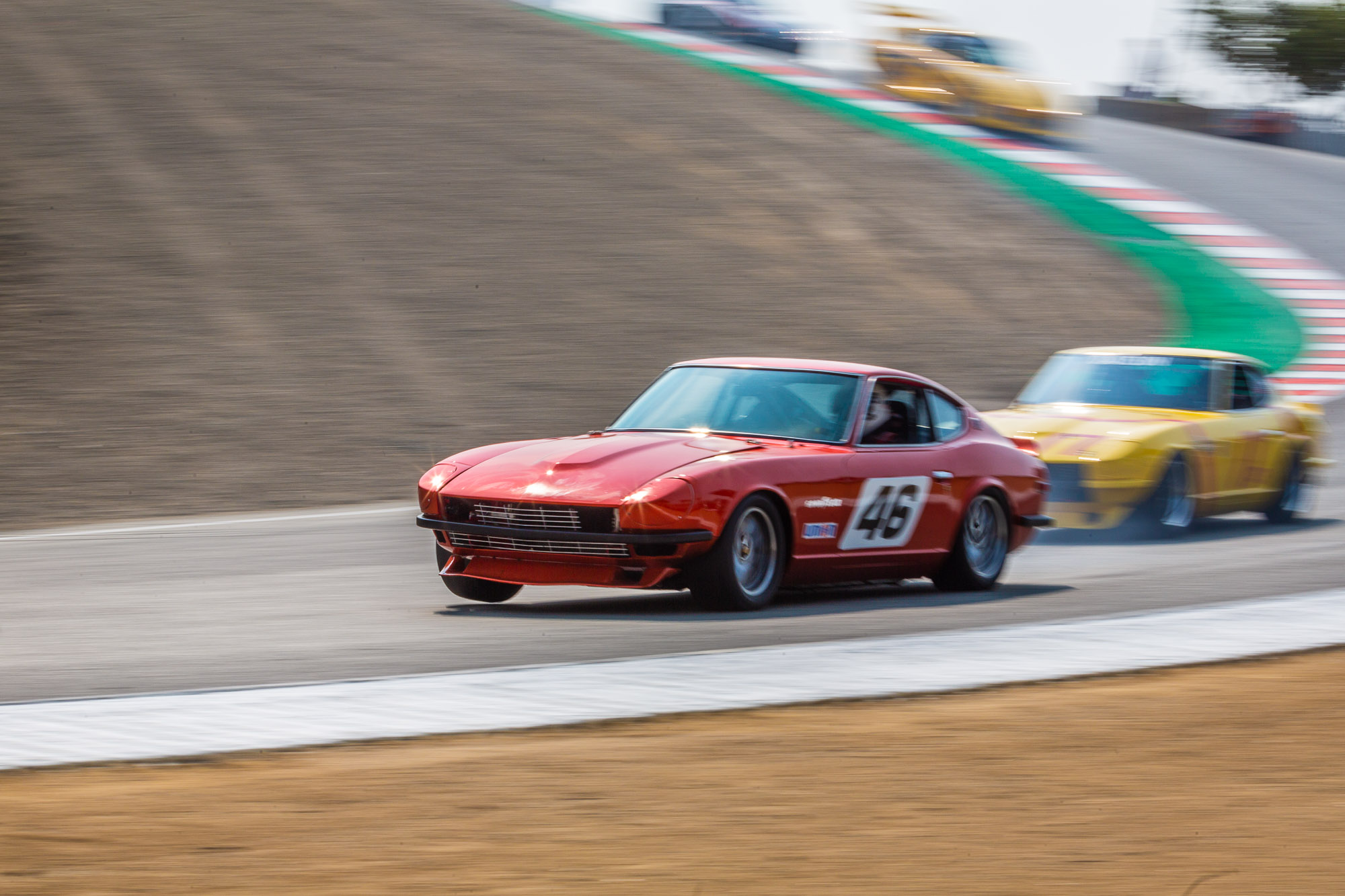 A Datsun 240Z at the Rolex Monterey Motorsports Reunion drives through the corkscrew section at Laguna Seca in Salinas, Calif. on August 25, 2018. (Eric Kayne/AP Images for Nissan)