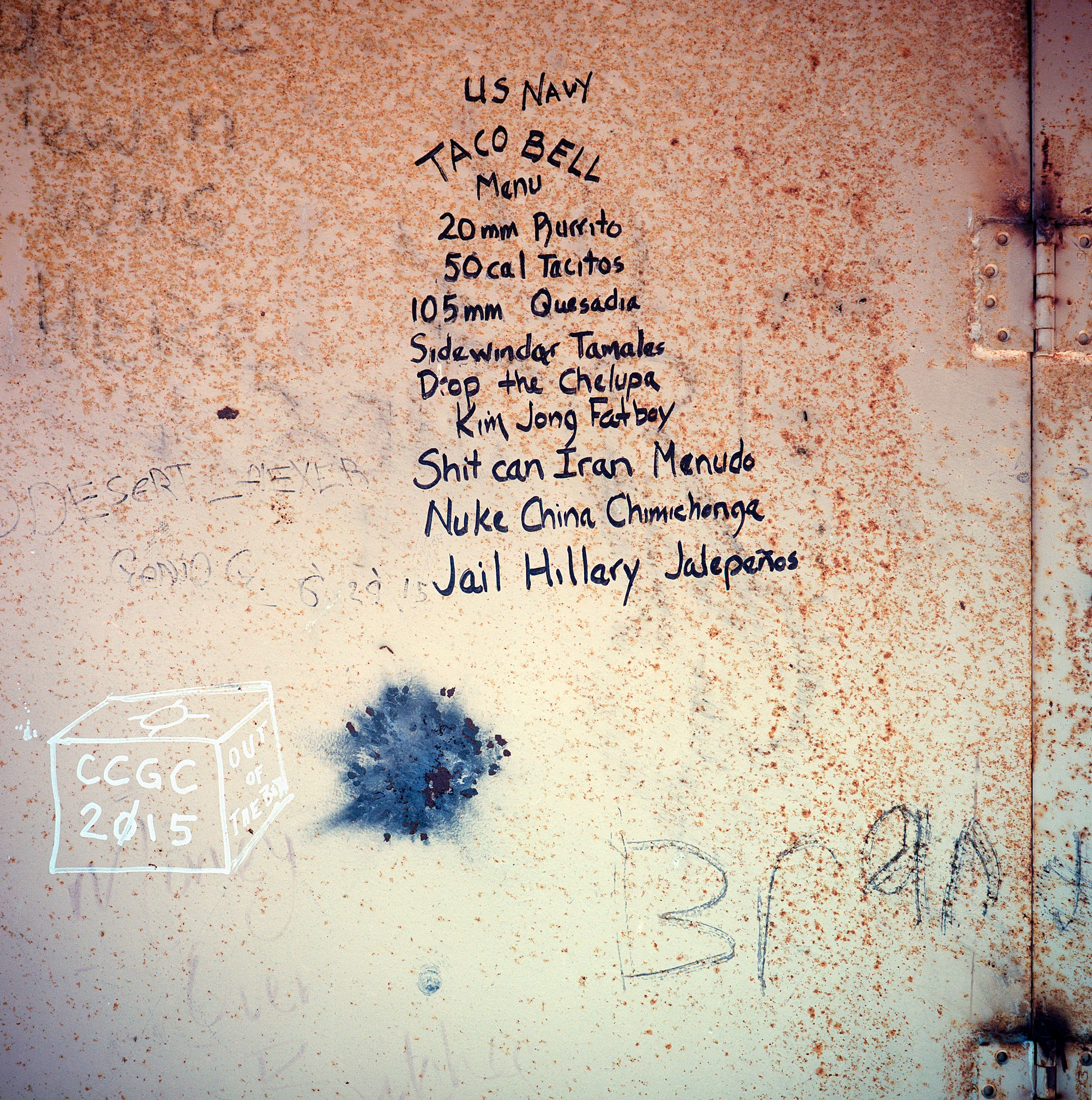 Graffiti covers a metal wall inside a target structure at the Dixie Valey Naval Training Area. The valley was acquired from local ranchers by the US Navy for electronic warfare simulation in 1995. The water table is very high in the area and many ranches in fact were beginning to experience sinkholes and subsidence.