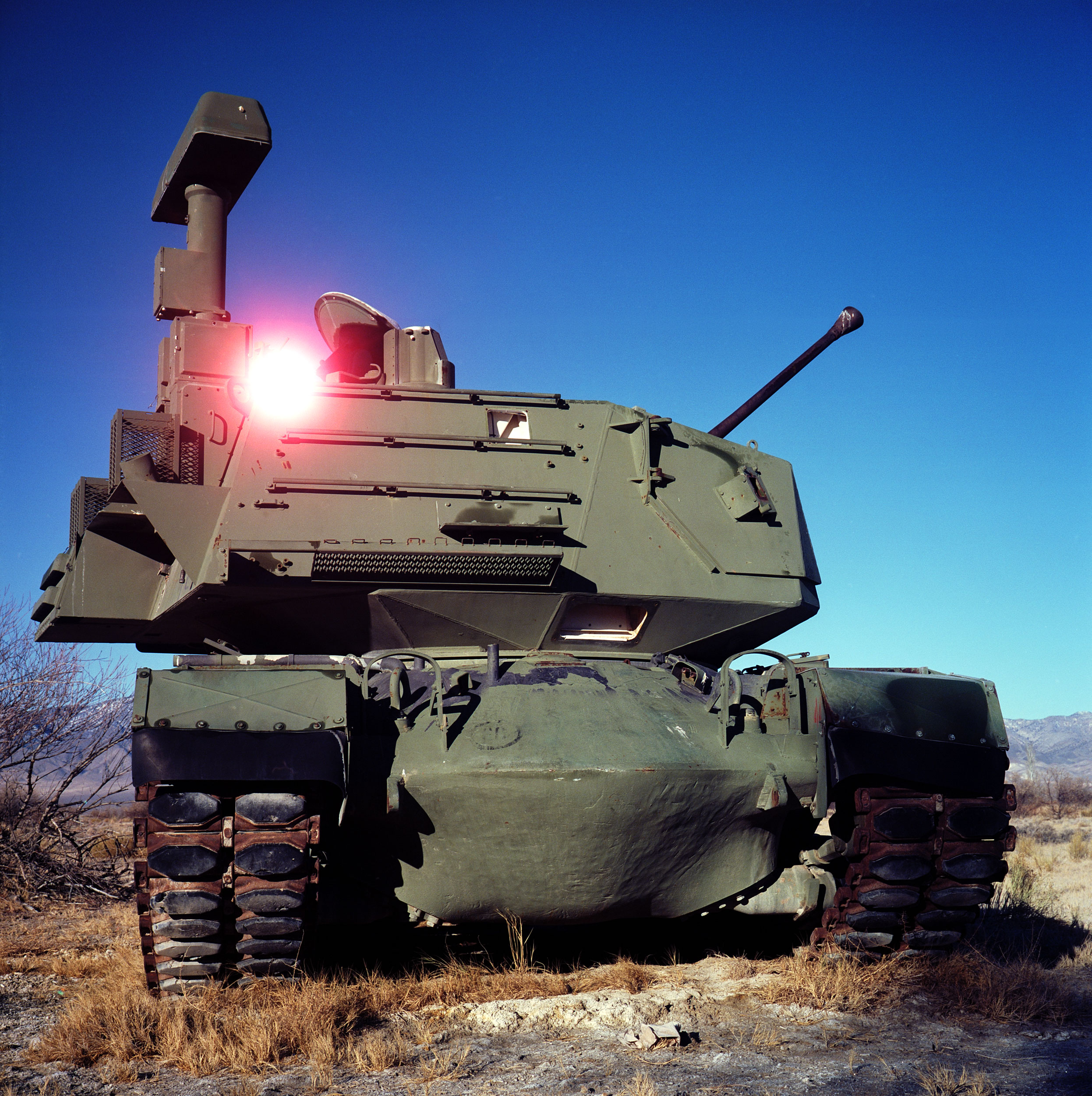 "A demilitarized tank sits at the Dixie Valley Naval Training Area. Dixie Valley was a small ranching community outside of Fallon, Nevada that was acquired by the US Navy for electronic warfare simulation in 1995. While most of the area is publicly accessible, a sign near the entrance states ""The land beyond this sign is used by NAS Fallon for military training. Low flying aircraft, military vehicles and personnel may be using flares, smoke/simulator grenades, and blank fire ordinance on this area at any time."" Needless to say, I wasn't attacked while I was there. The area was quiet and vast. While researching the area, where other demilitarized vehicles and radar stations are spread across the valley, it was suggested that Dixie Valley was used to mock an invasion by a foreign power on American soil. Also, the Navy's ""TOPGUN"" program (Naval Fighter Weapons Program), moved from Miramar, California to the area a year after Dixie Valley was acquired. If anyone has an idea of what kind of tank this is, please let me know in the comments!"