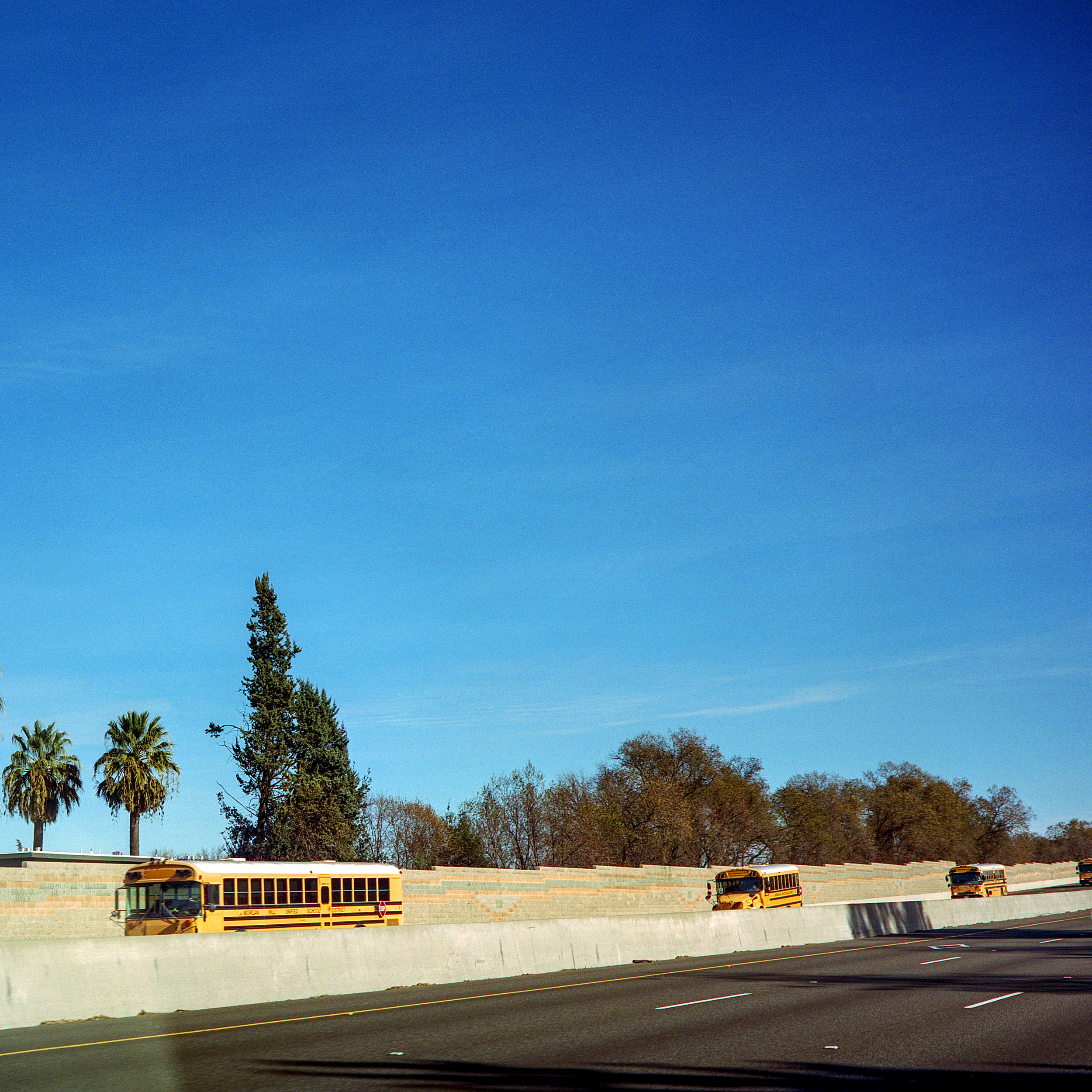 Buses traveling back from the sierras to a school district near San Jose.