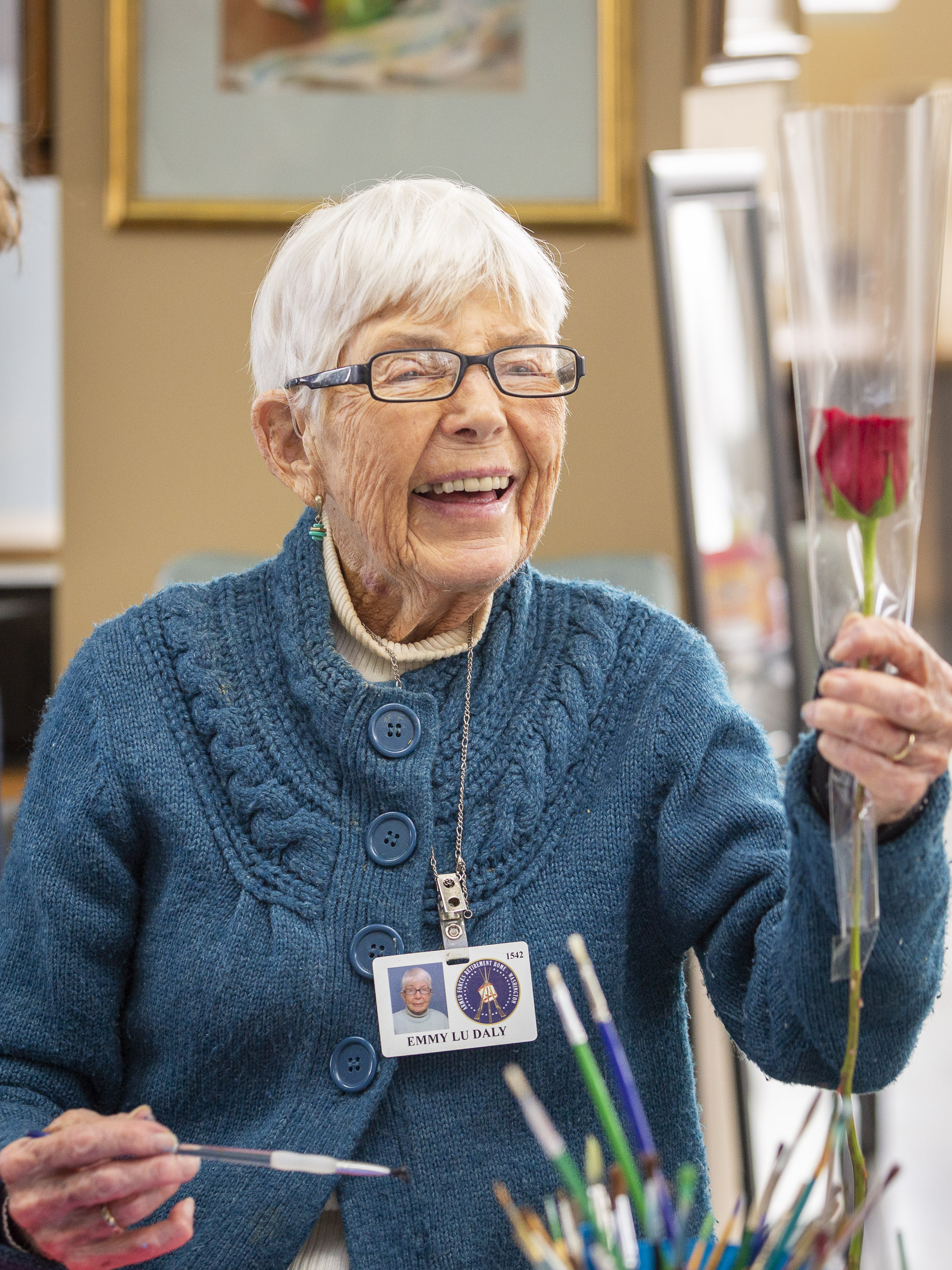 A military veteran receives a rose from 1-800-Flowers.com at the Armed Forces Retirement Home on Valentine's Day on Thursday, Feb. 14, 2019 in Washington, DC.