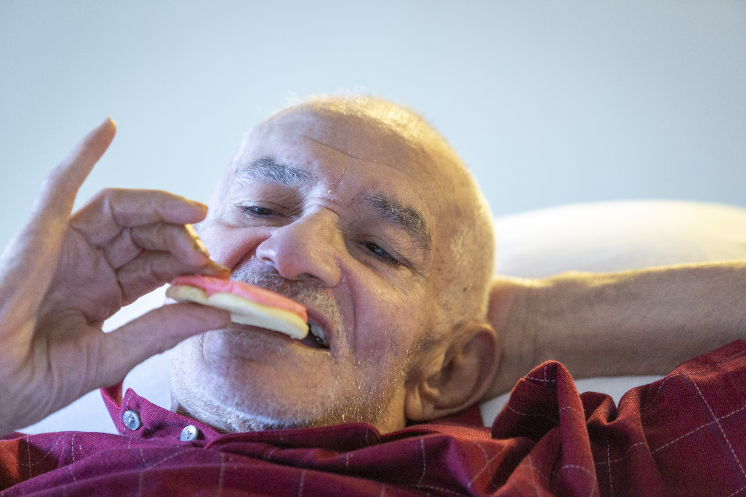 A military veteran takes a bite of a cookie from Cheryl's Cookies at the Armed Forces Retirement Home on Valentine's Day on Thursday, Feb. 14, 2019 in Washington, DC.