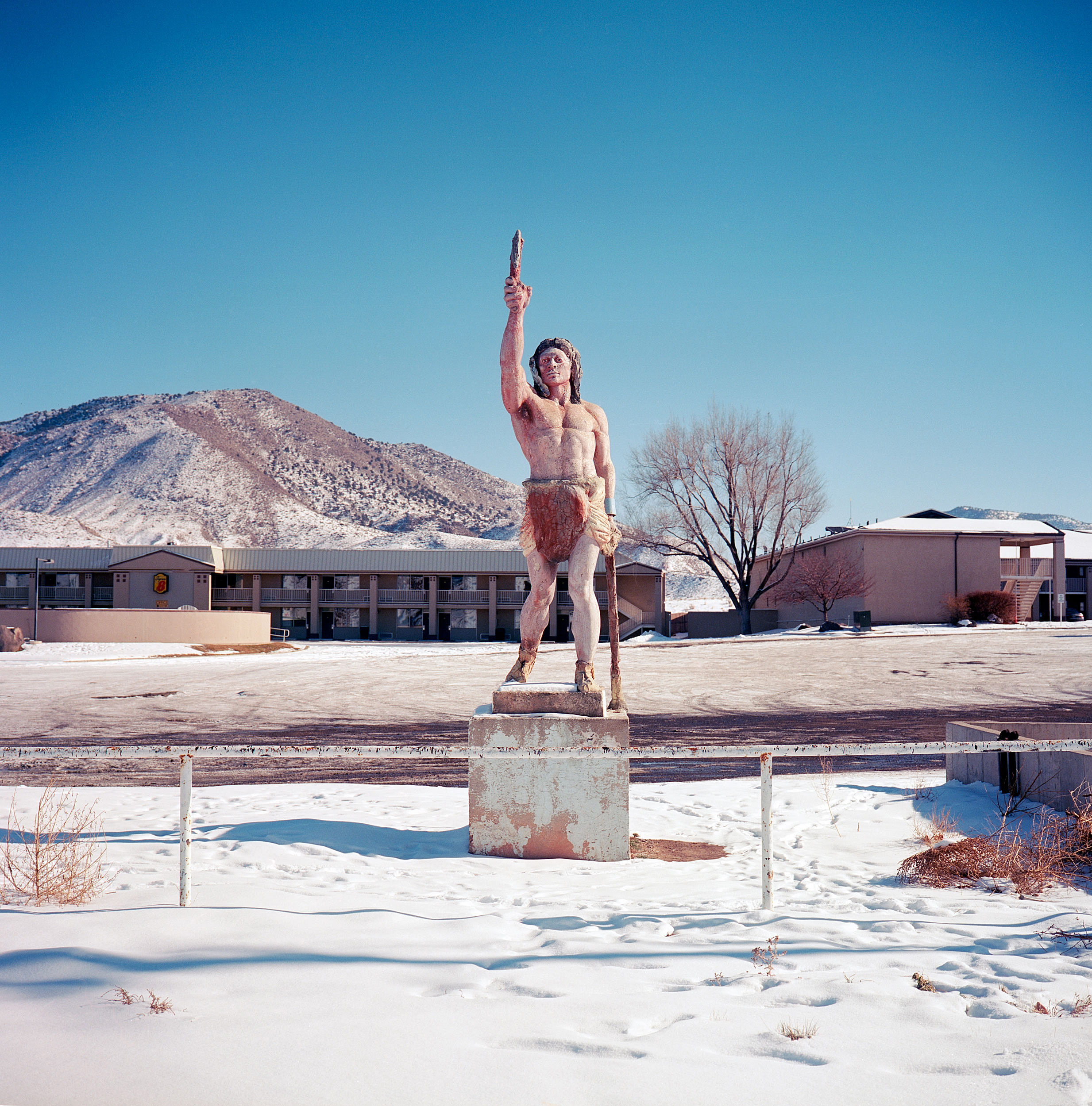 A roadside Native American statue in Salina, Utah. The statue used to be a slave holding a cup, but was rebuilt sometime between 2003 and 2004. The cup was changed to an axe, and the slave was transformed into a Native American.