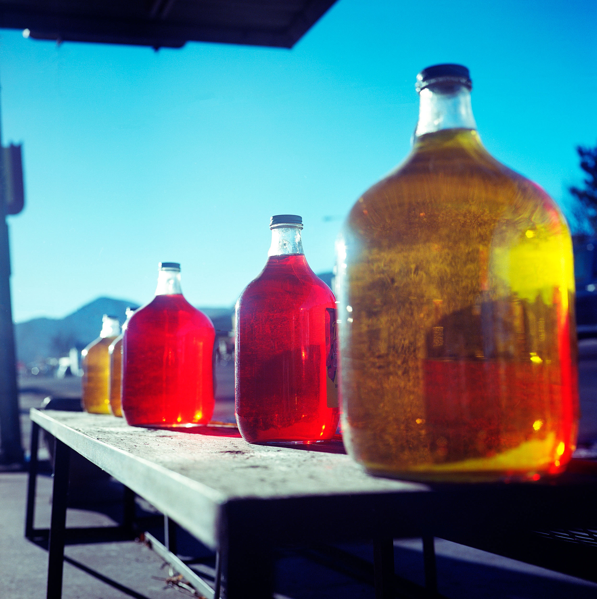 Cañon City, Colorado. These colorful cider bottles with the sun streaking through them caught my eye, but not just because of the color, but because they were very dusty. It boggled my mind that someone would put these bottles out for display to entice shoppers to stop inside their store wouldn't clean their product of dust I could see from a moving car passing by on the street. I stopped and grabbed a few shots of totally meaningless eye candy, and then noticed an old Chevy around the corner in the parking lot. I made a few shots when an older woman with a heavy Germanic accent aggressively confronted me to ask what I was doing. I told her I was taking a picture of the car and she replied that there had been a lot of vandalism lately. Mind you, this was in the middle of the day along a major artery of Cañon City, in a parking lot that was empty save for the Chevy. All in all, not a great first impression for Cañon City. I cut off her rant by apologizing for disturbing her and walked back to my car. It's too bad because in hindsight, I would have loved to make her portrait and buy some cider.