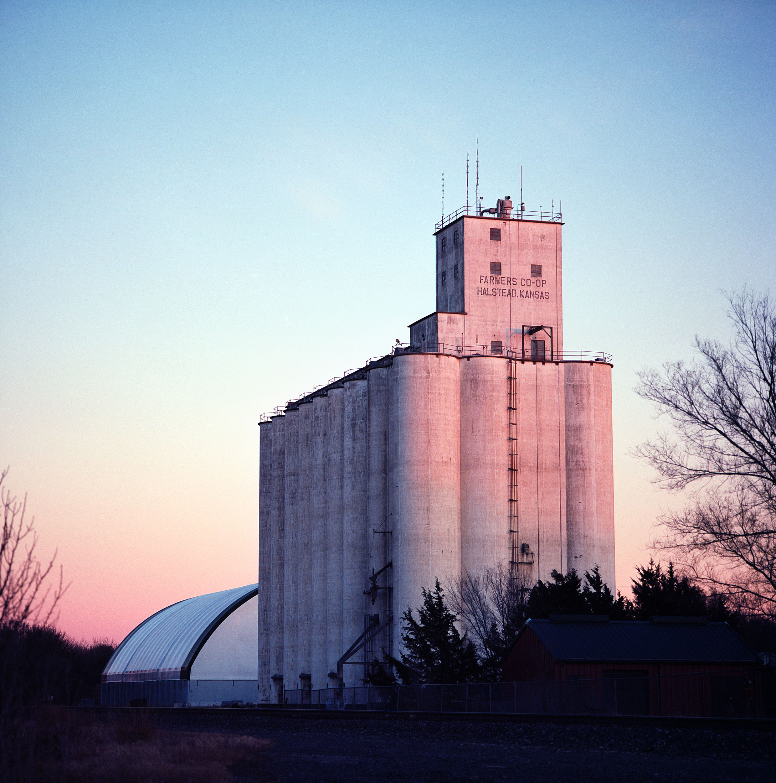 Grain mill, Halstead, Kansas, photographed after eating a Subway sandwich. I realize grain mills at dusk are visual low hanging fruit, but I couldn't resist!