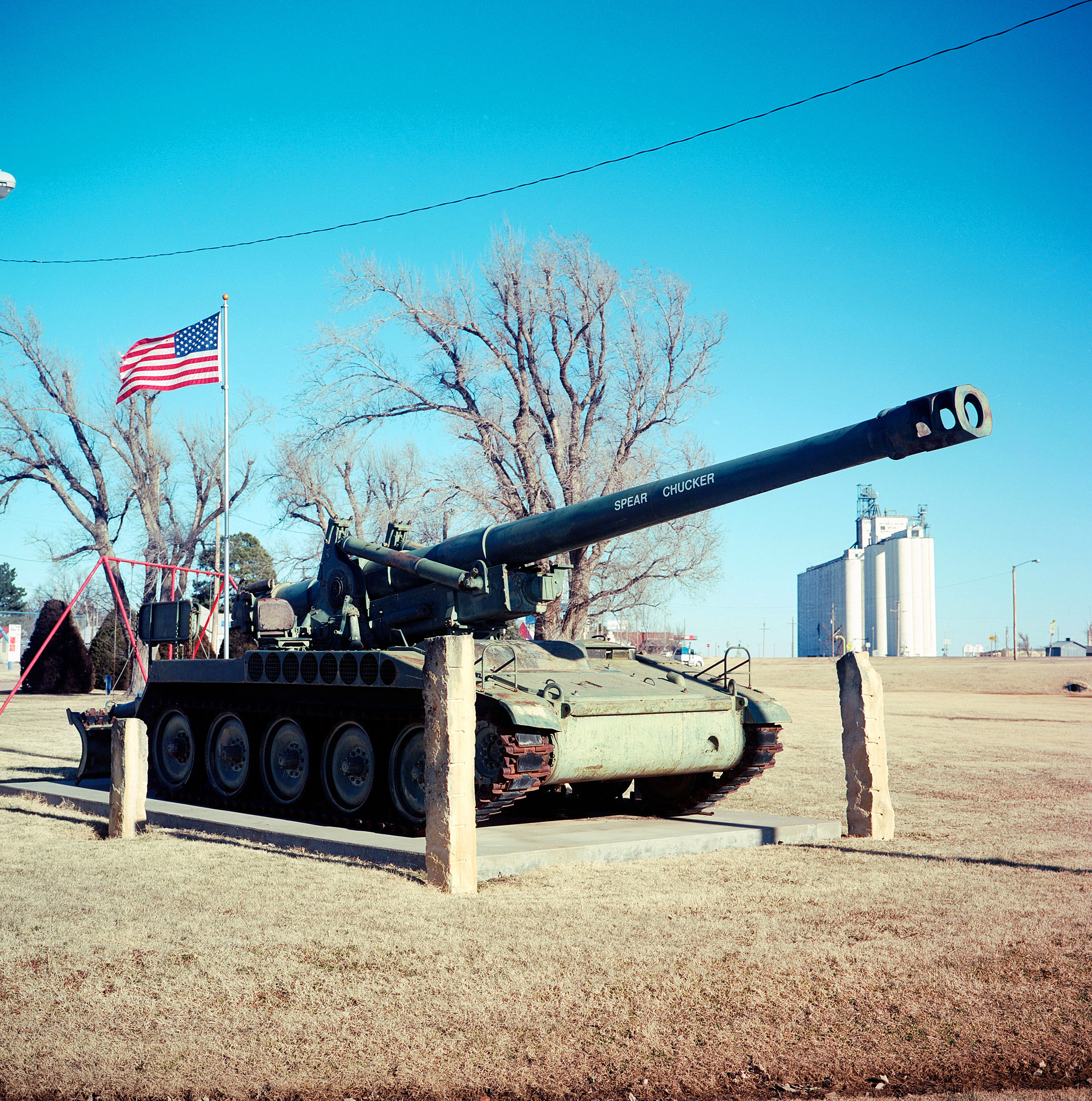 "A decommissioned tank with the words ""Spear Chucker"" on the turret sits in the Offerle, Kansas city park."