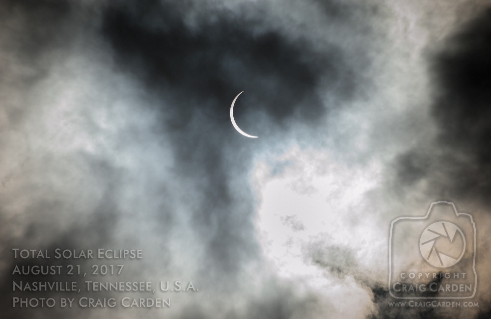 """A few seconds before totality, a small cluster of clouds passed over the West End of Nashville, eliciting an audible cry of dismay from the crowd in Centennial Park, as well as the small group that had gathered with us. One of the women on the roof behind us gave a humorous voice to our apprehension, quipping, """"Everybody blow at them! As hard as you can!"""""""