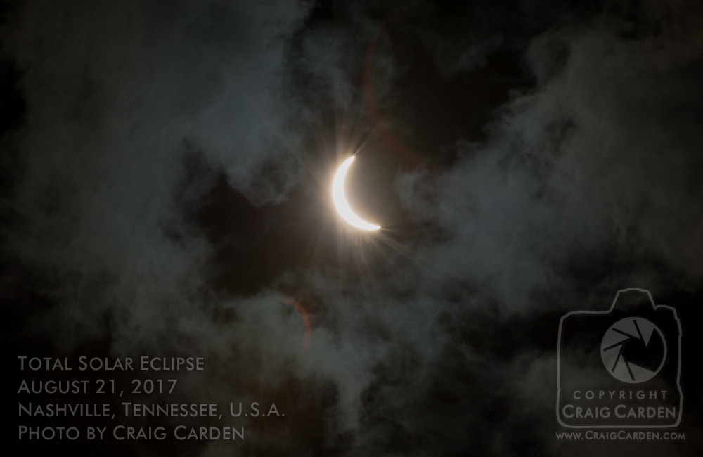 """The last few rays of the soon-to-be-eclipsed sun, streaming through the thin edges of the departing clouds. It's a great example of how a moment that seems """"lost"""" can sometimes surprise us by turning into something wondrous."""