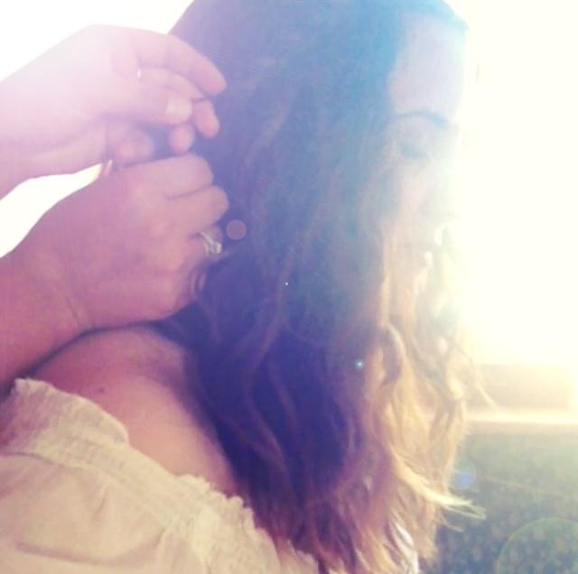 my dear friend mary-caitlin braiding my hair.