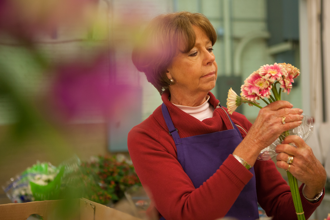 Making sure all the flowers are intact and perfect for arrangements.
