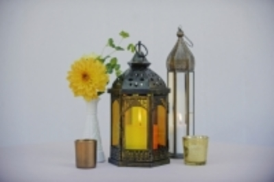 """Moroccan candle lanterns-3 styles, hold 3""""x3"""" pillar and 2""""x3""""pillar candles  $15 each  Photo: Michelle Turner"""