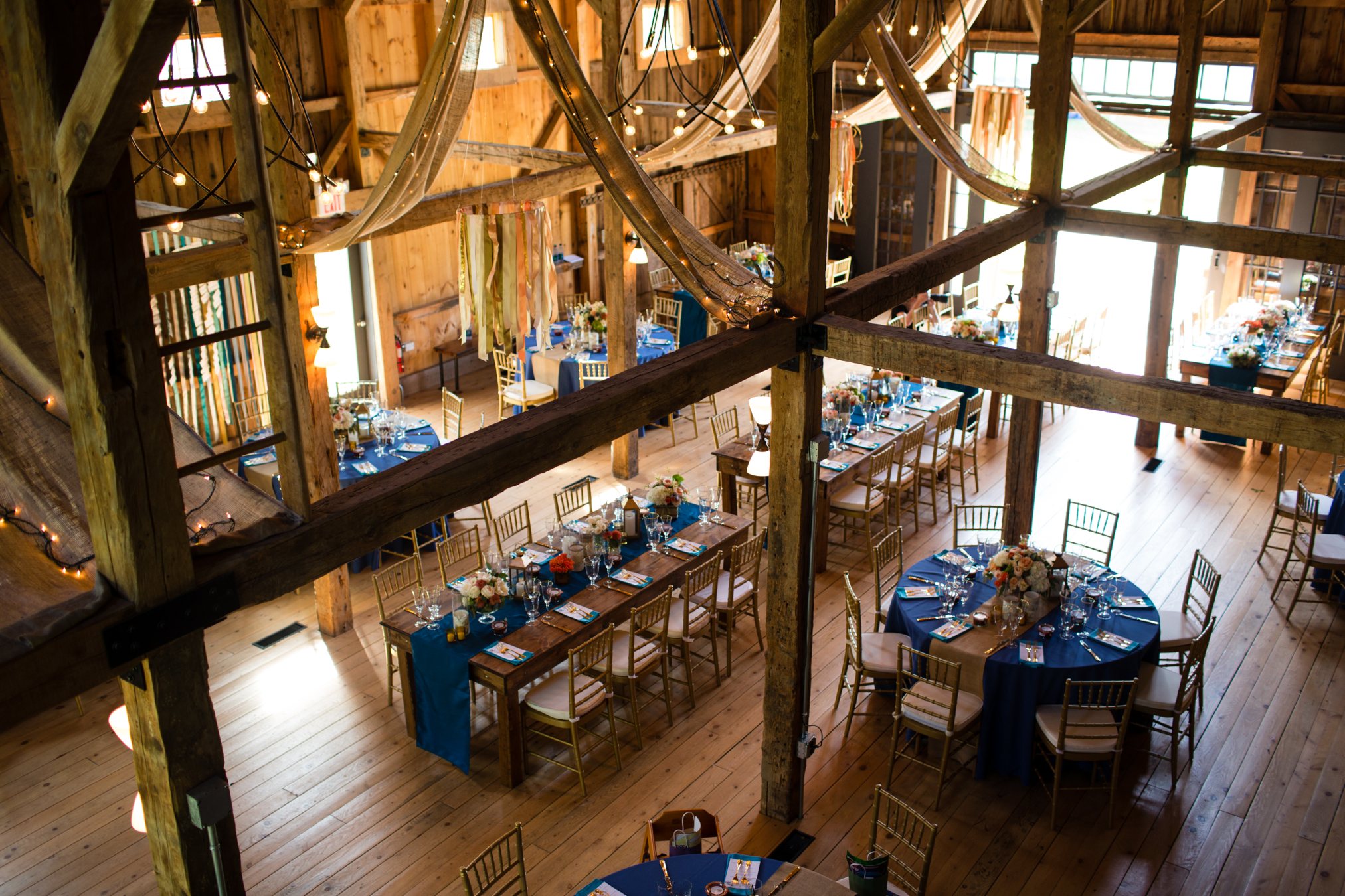 Maine Seasons events Barn wedding tables photo Emilie, Inc..jpg