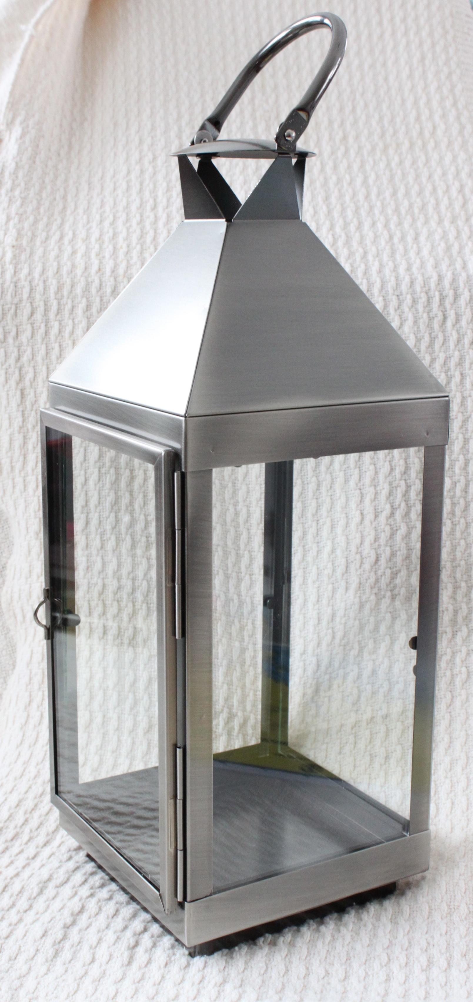 """Silver lanterns hold 3""""x3"""" or 3""""x 6""""  pillar 16"""" tall x 5.5"""" square  $15 each"""