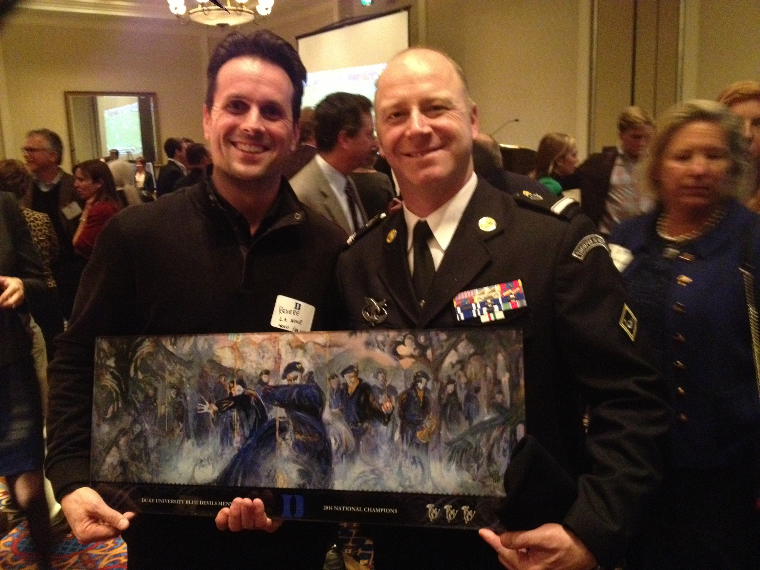 Major Lakomy was presented with a replica print of the Alpine Gothic installation commemorating Duke's 2014 Men's Lacrosse National Championship.