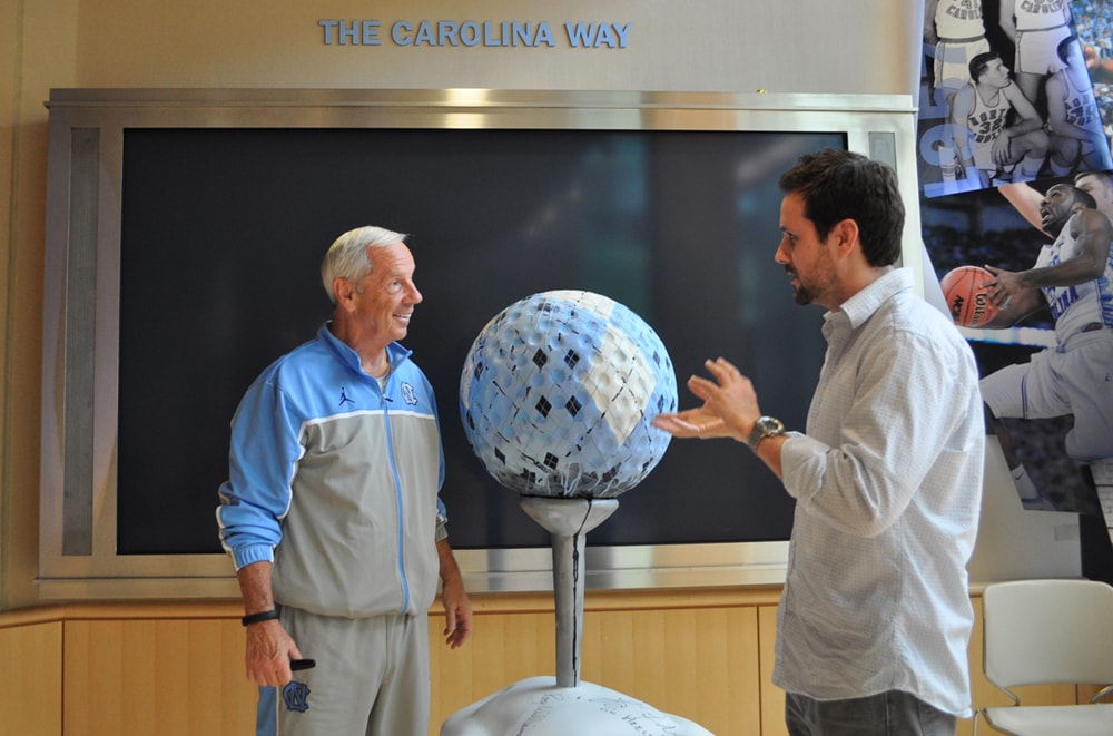 Roy Williams and Revere La Noue discuss the creation of a larger golf club