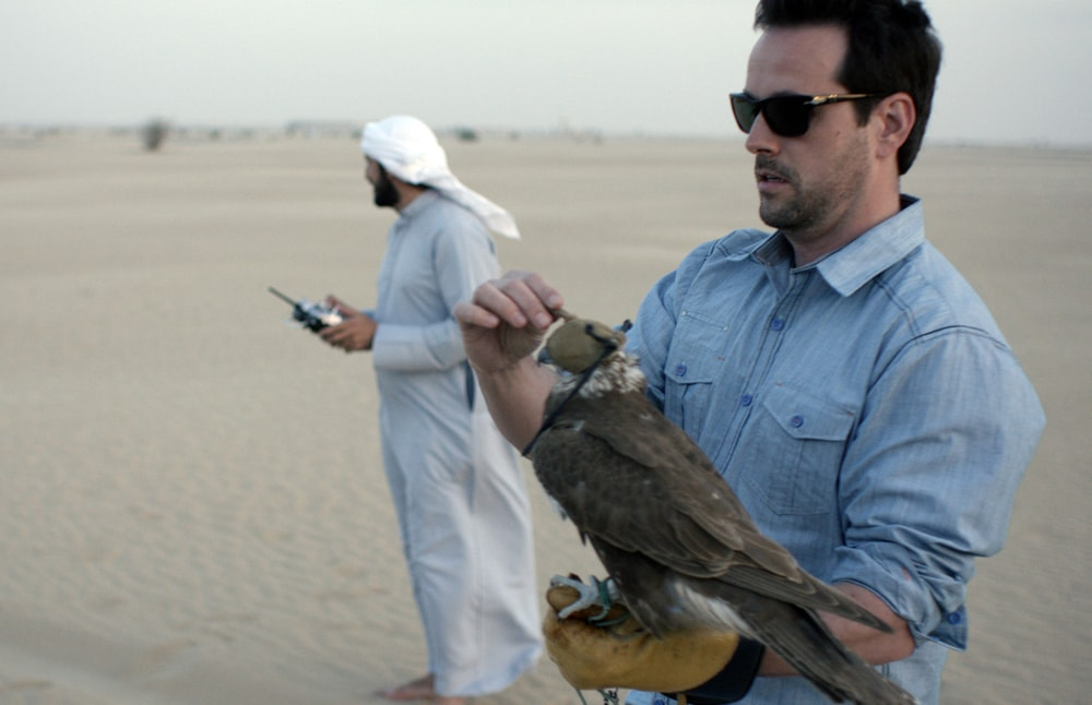Revere trying his hand at falcon racing in Dubai with the fastest creature on earth
