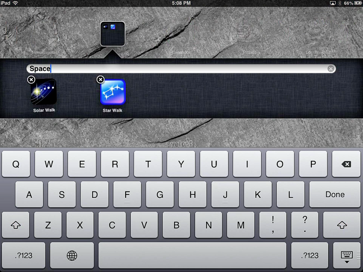 iPad screen with a folder holding 2 apps