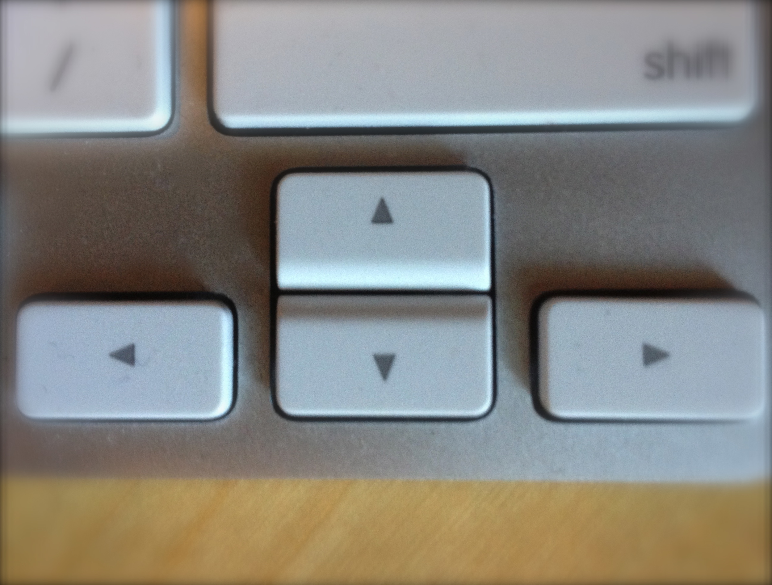 Close up of the arrow keys on an Apple Wireless Keyboard
