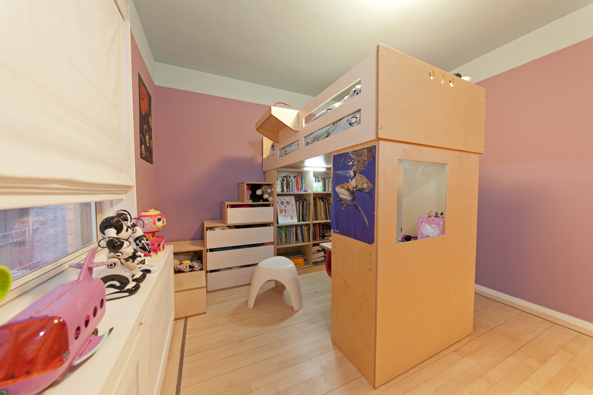 Storage stairs along the wall, allow for drawers and shelves to be accessible from the side