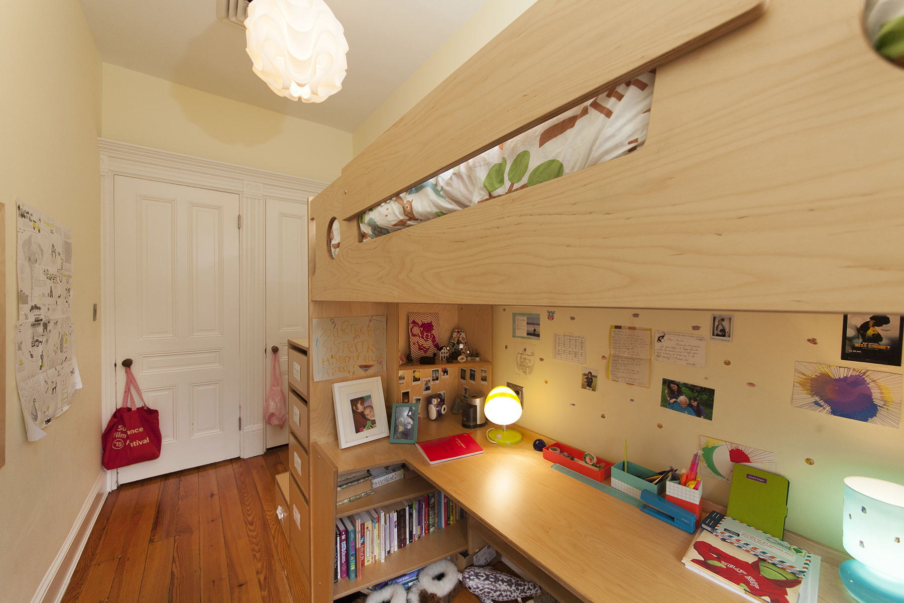 custom solution for a narrow bedroom. Natural plywood furniture