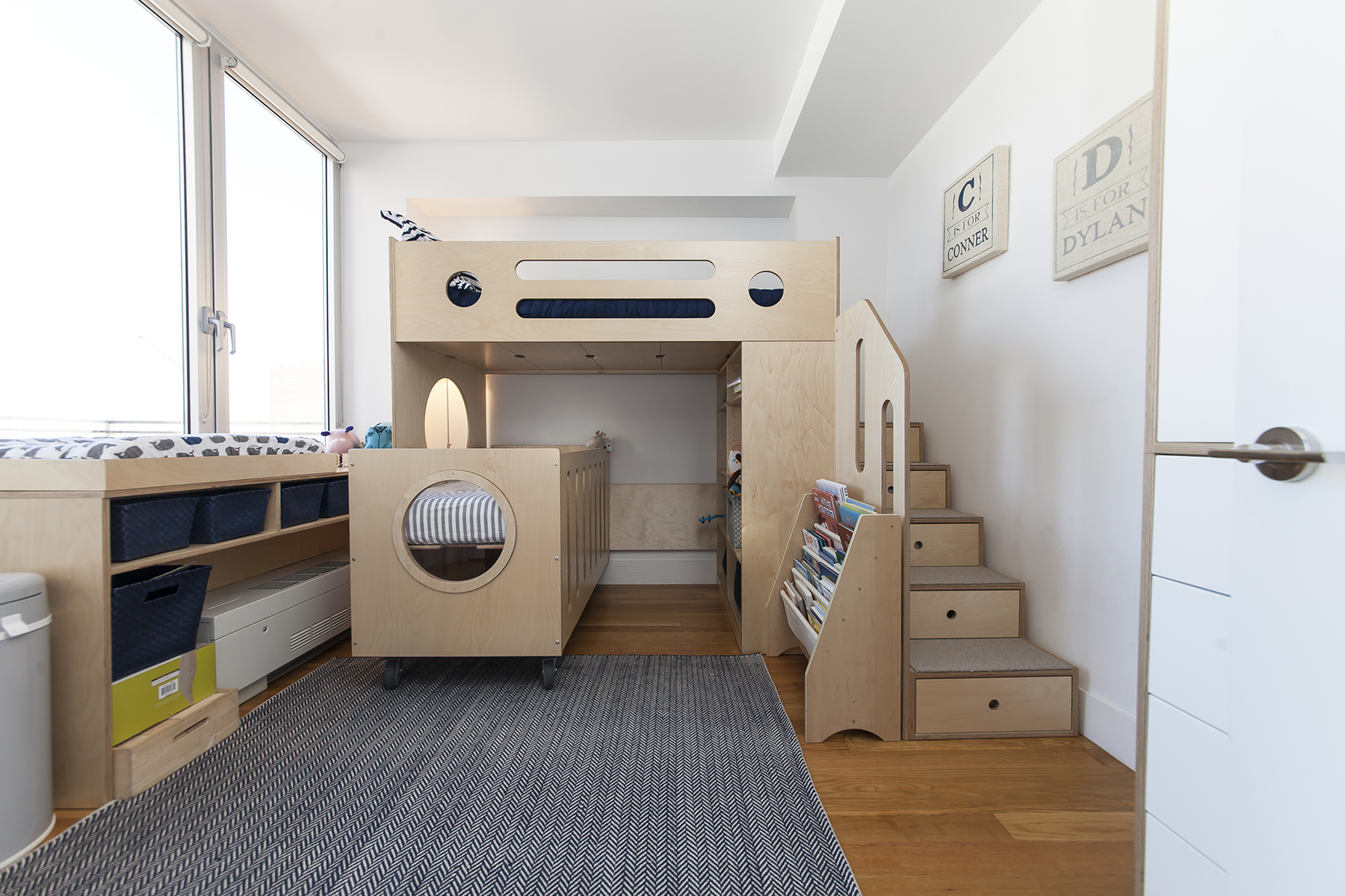modern bunk bed with stairs and crib