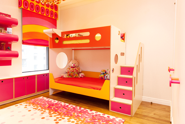 A custom cutout creates a window to a window, allowing light to pass through the bunkbed into the room.
