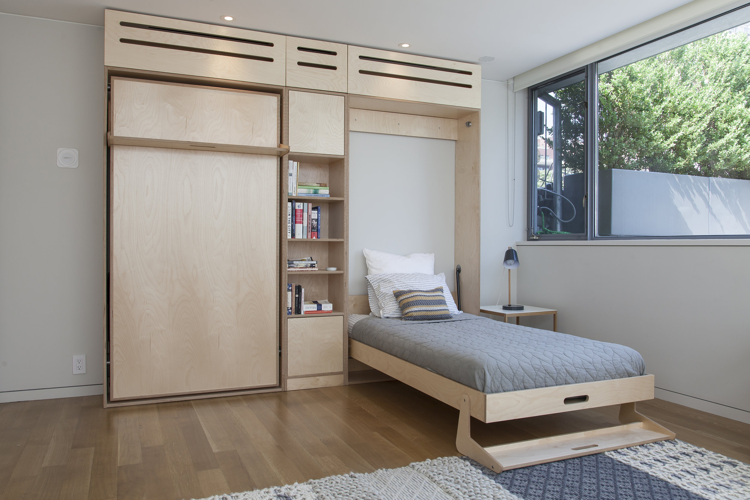 minimalist murphy  bed with shelves