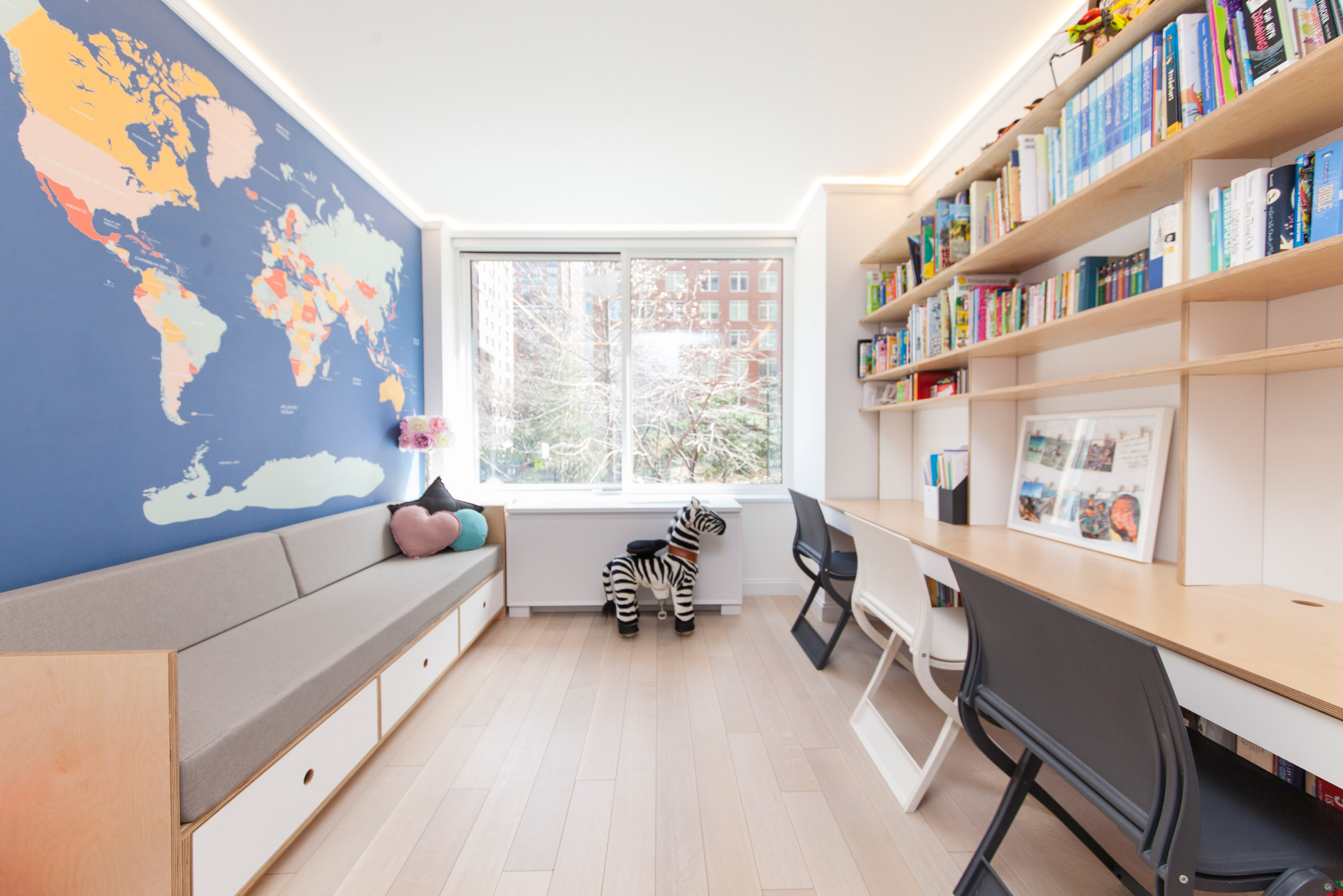 casa kids playroom with bench and floating desk