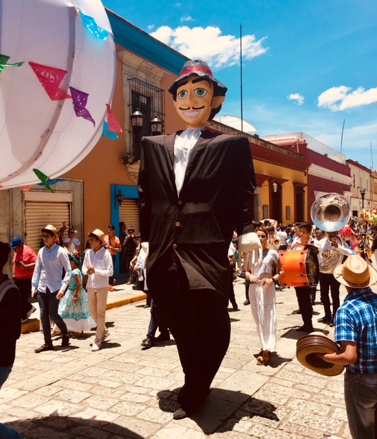 Streets of Oaxaca are alive during folk festival known as Guellaguezza in July.