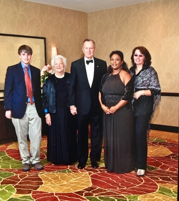 Performing for president Bush in Houston. With my piano student Jason Miller. I open performance opportunities to my students.