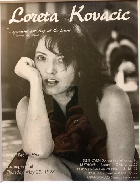 """One of Loreta""""s posters from Carnegie Hall performance."""