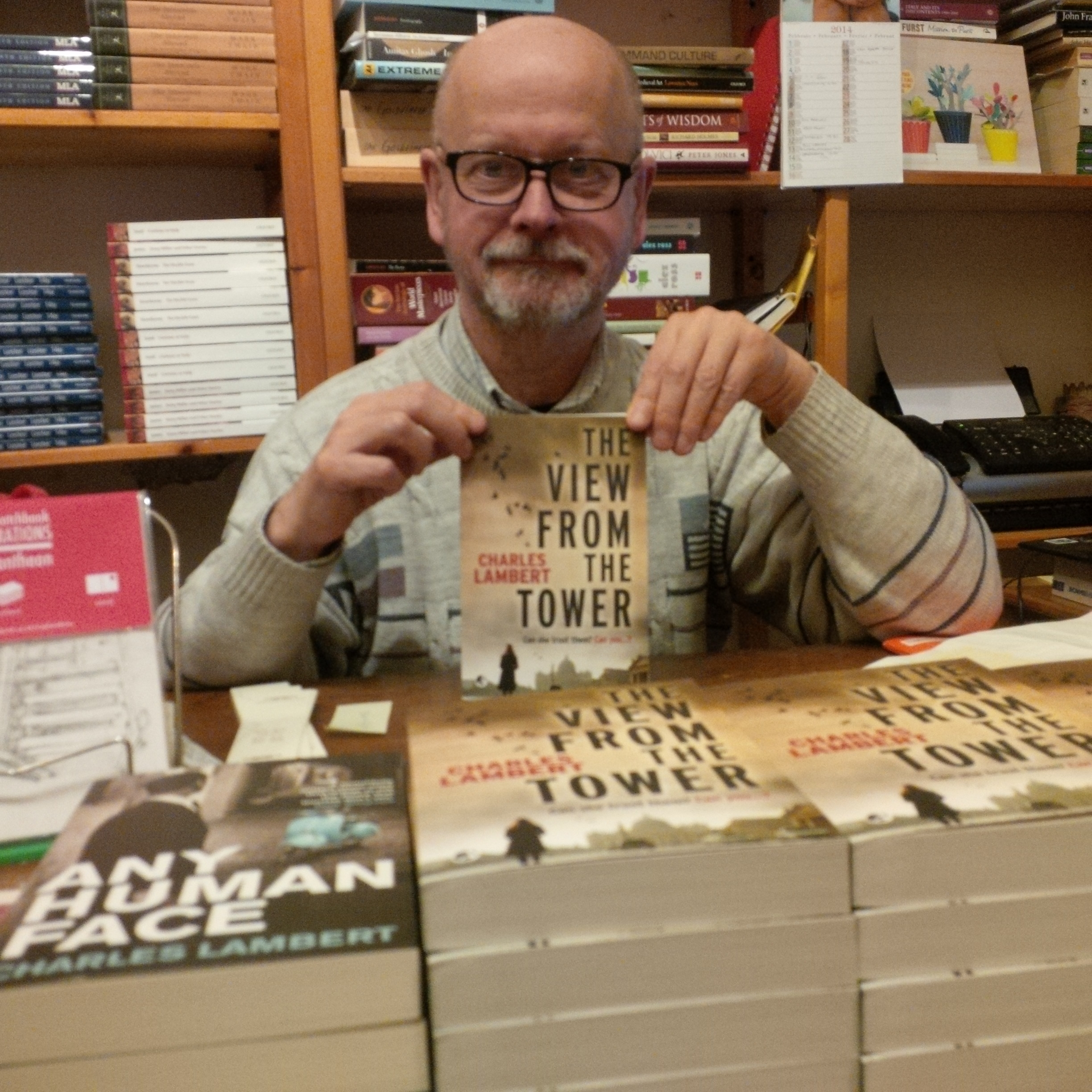 Dermot O'Connell (Almost Corner Bookshop) with copies of THE VIEW FROM THE TOWER by Charles Lambert.